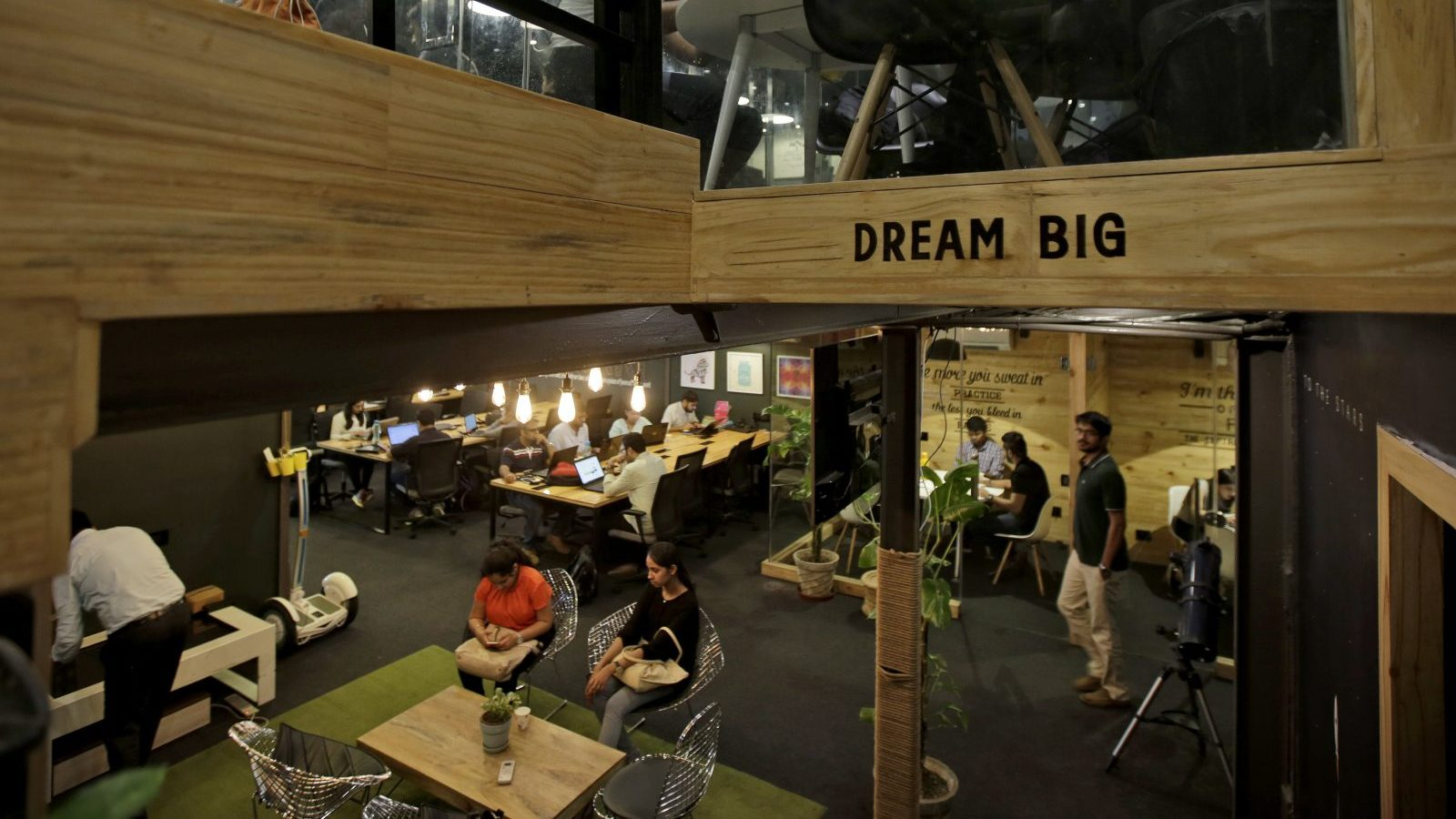 In this Aug. 19, 2016 photo, young Indian entrepreneurs and freelancers work inside Innov8, a lax co-working space in New Delhi, India. As India emerges as one of the biggest markets in the world for tech-based startups, workspaces are transforming from traditional and hierarchal, to relaxed and bar-like. With more than 4,200 new tech-based companies by the end of last year, India has become the third largest market for startups, according to The National Association of Software and Services Companies (NASSCOM), an Indian software industry research company. (AP Photo/Altaf Qadri)