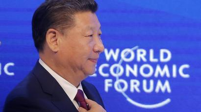 China's President Xi Jinping adjusts his tie at the World Economic Forum in Davos, Switzerland, Tuesday, Jan. 17, 2017.