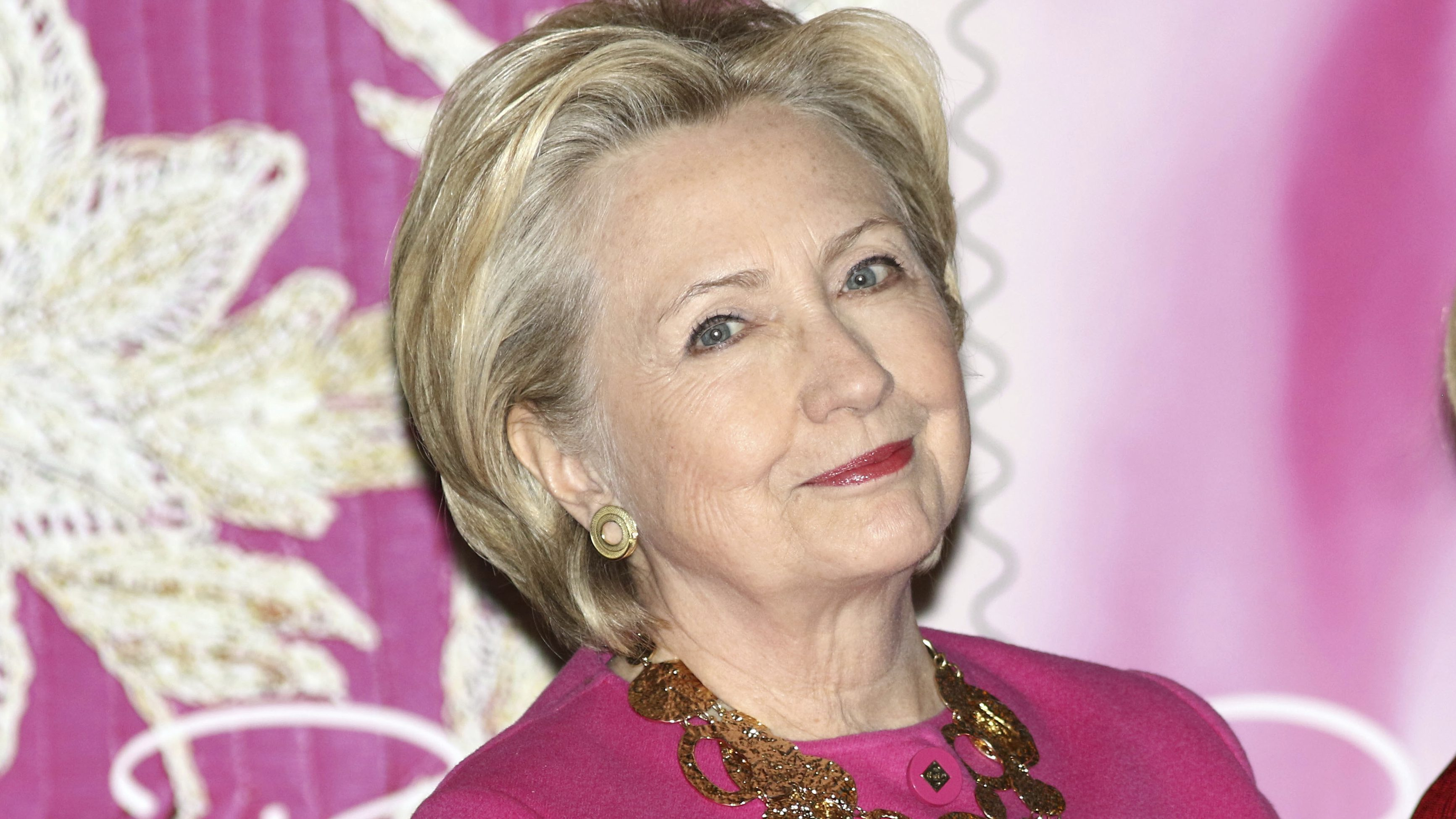 Hillary clinton in a pink jacket