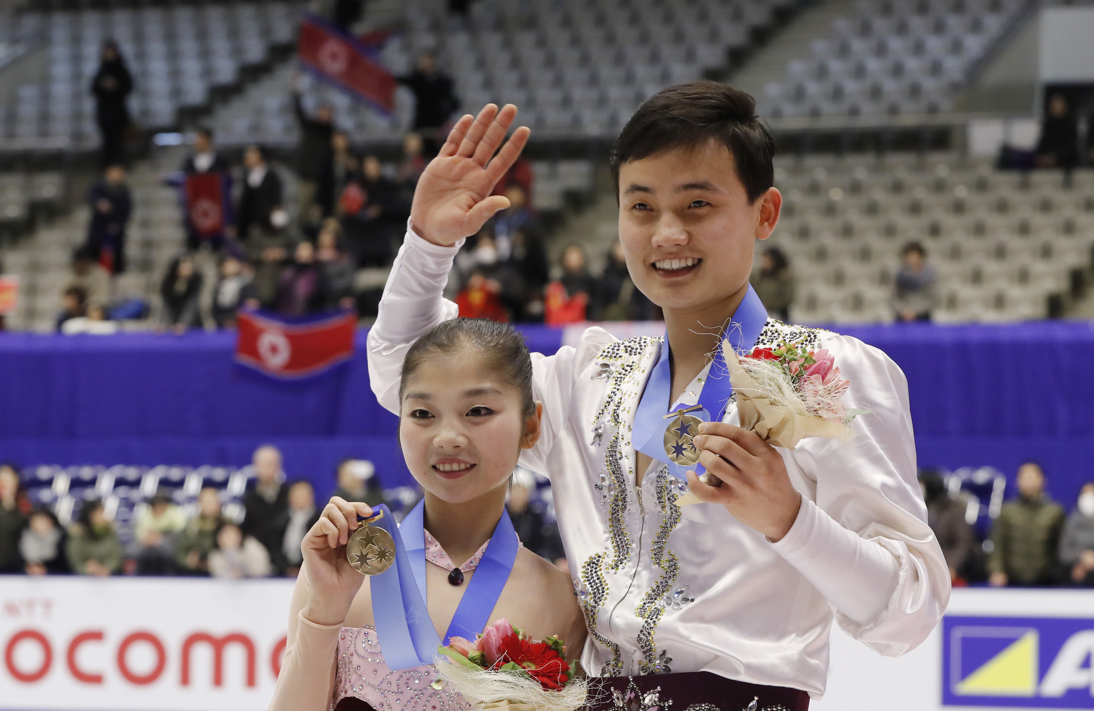 Bronze medalists Ryom Tae Ok and Kim Ju Sik of North Korea pose for photographers during the victory ceremony of the Pairs event of Figure Skating competition at Makomanai Indoor Skating Rink at the Asian Winter Games in Sapporo, northern Japan, Saturday, Feb. 25, 2017.