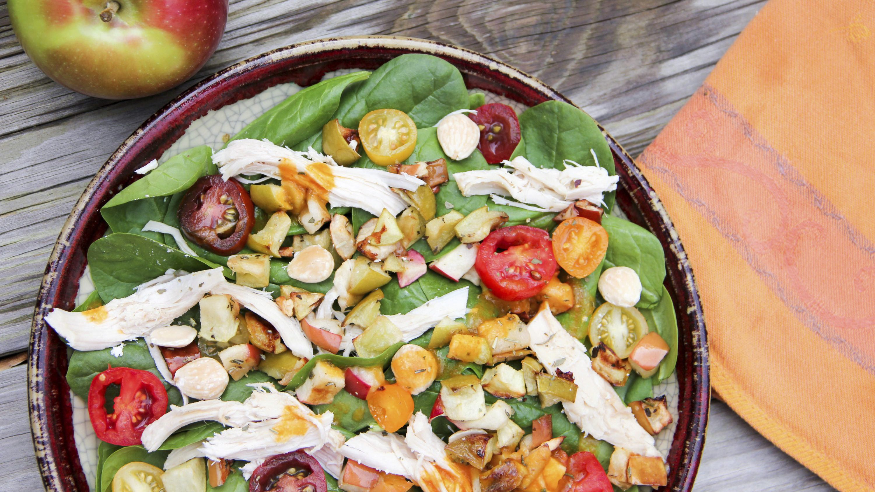 This Nov. 6, 2017 photo shows a green salad with roasted apple and pumpkin vinaigrette in Bethesda, Md. This dish is from a recipe by Melissa d'Arabian.