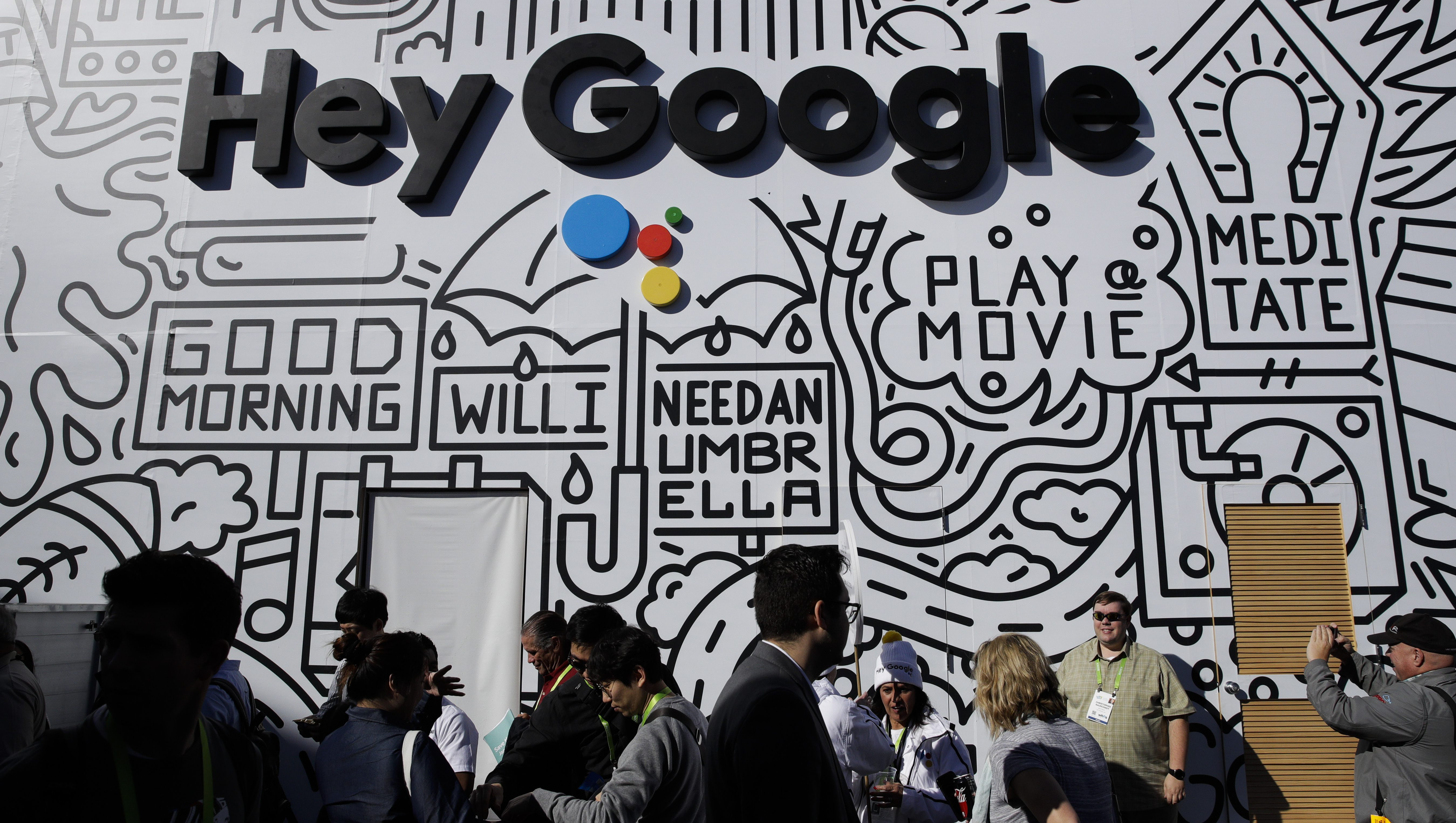People wait in line to enter the Google booth at CES International, Wednesday, Jan. 10, 2018, in Las Vegas. (AP Photo/Jae C. Hong)