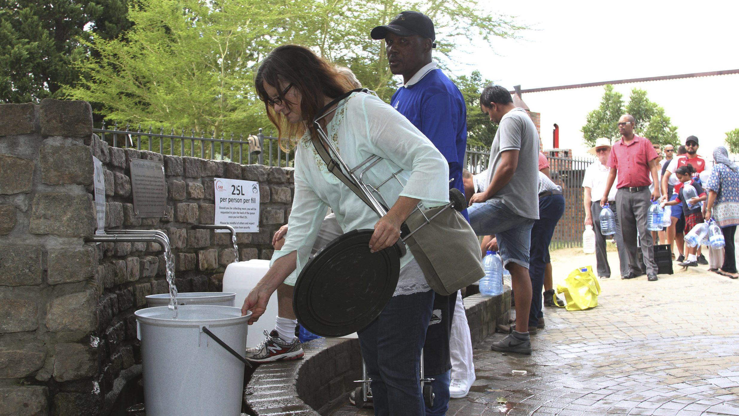 Collecting water at a tap in Cape Town.