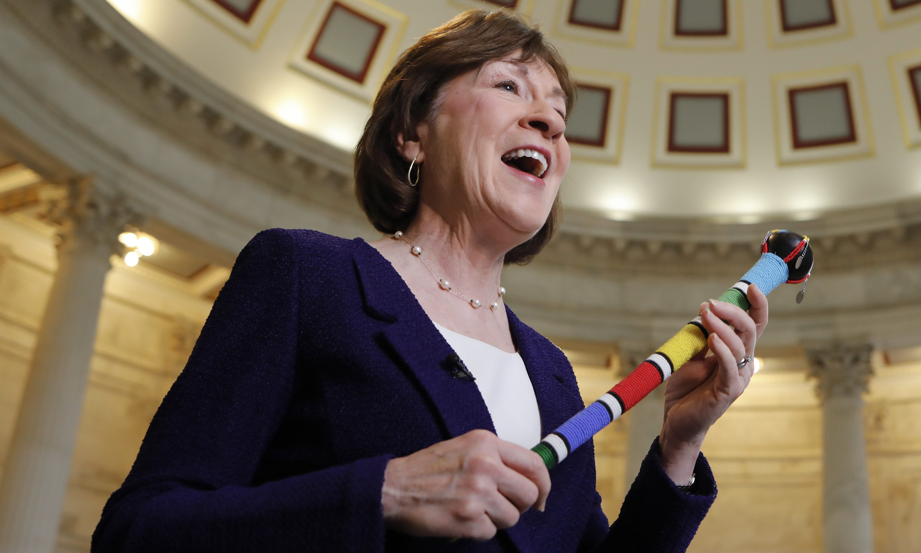 Sen. Susan Collins, R-Maine, who moderated bipartisan negotiations holds her walking stick