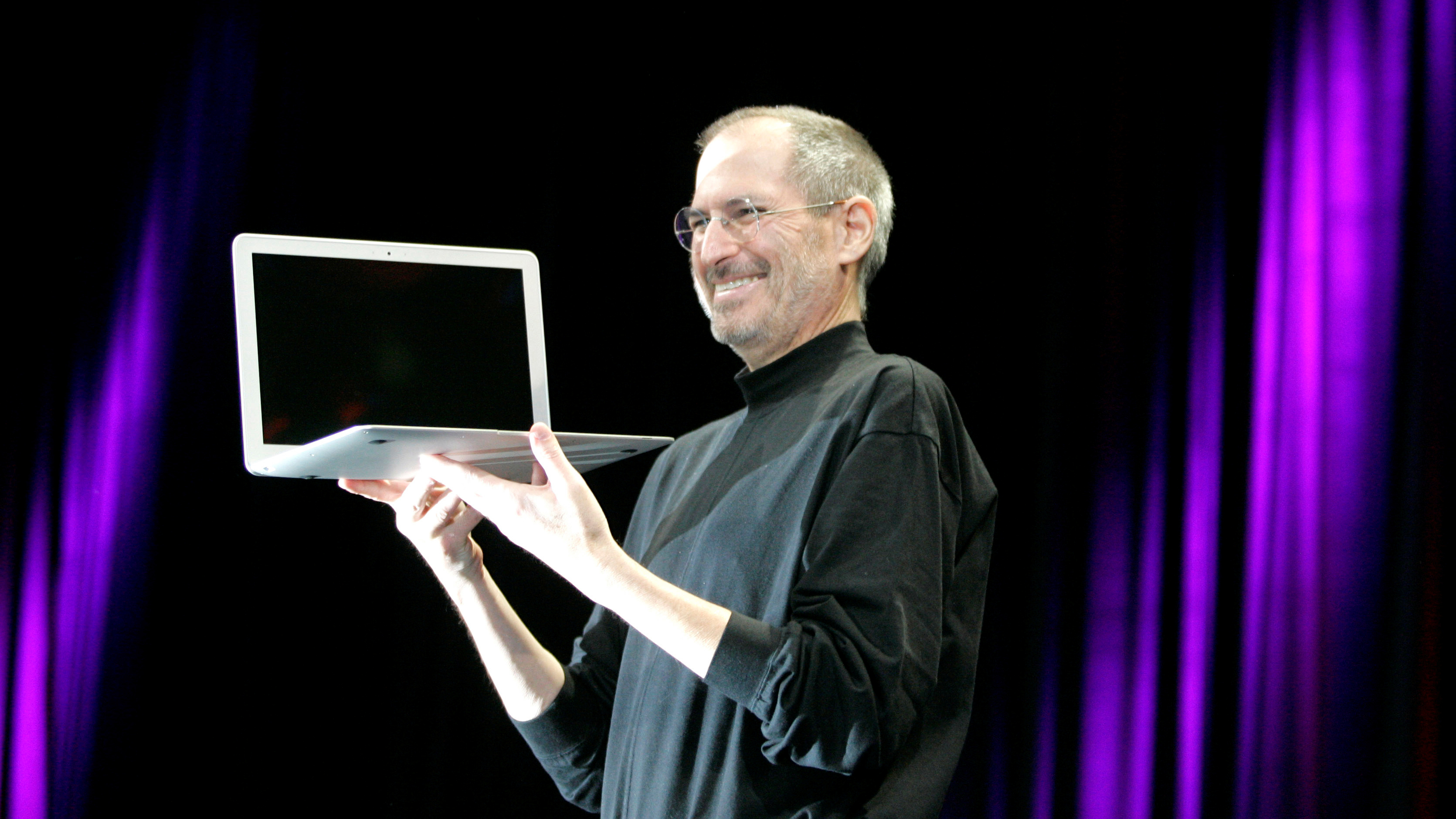 Apple CEO Steve Jobs holds up the new MacBook Air portable computer after giving the keynote address at Apple MacWorld Conference in San Francisco, Tuesday, Jan. 15, 2008. (AP Photo/Jeff Chiu)