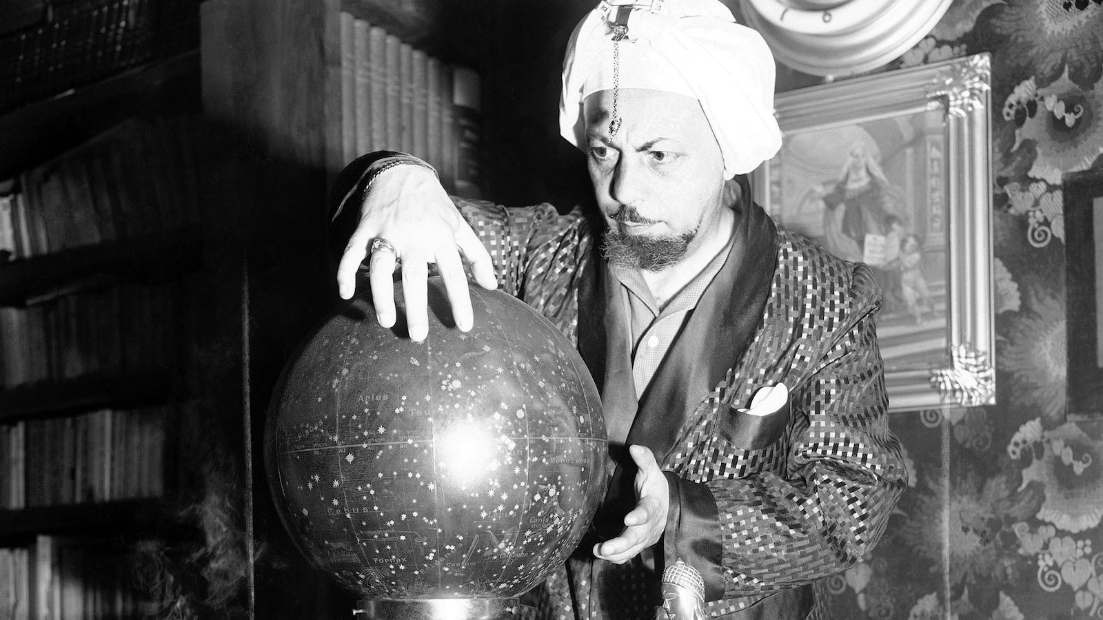 "Whenever an event of importance happens in Italy, it is the fashion of some Romans to consult Professor Lelio Alberto Fabriani, the ""Magician of Rome"", shown June 27, 1952 for his spectral interpretation of it. The professor was asked to look into his globe when twin girls were born to actress Ingrid Bergman and her husband Roberto Rossellini. The professor peered and peered into his globe of the sky and finally predicted; ""They will not become celebrities."" (AP Photo/Mario Torrisi)"