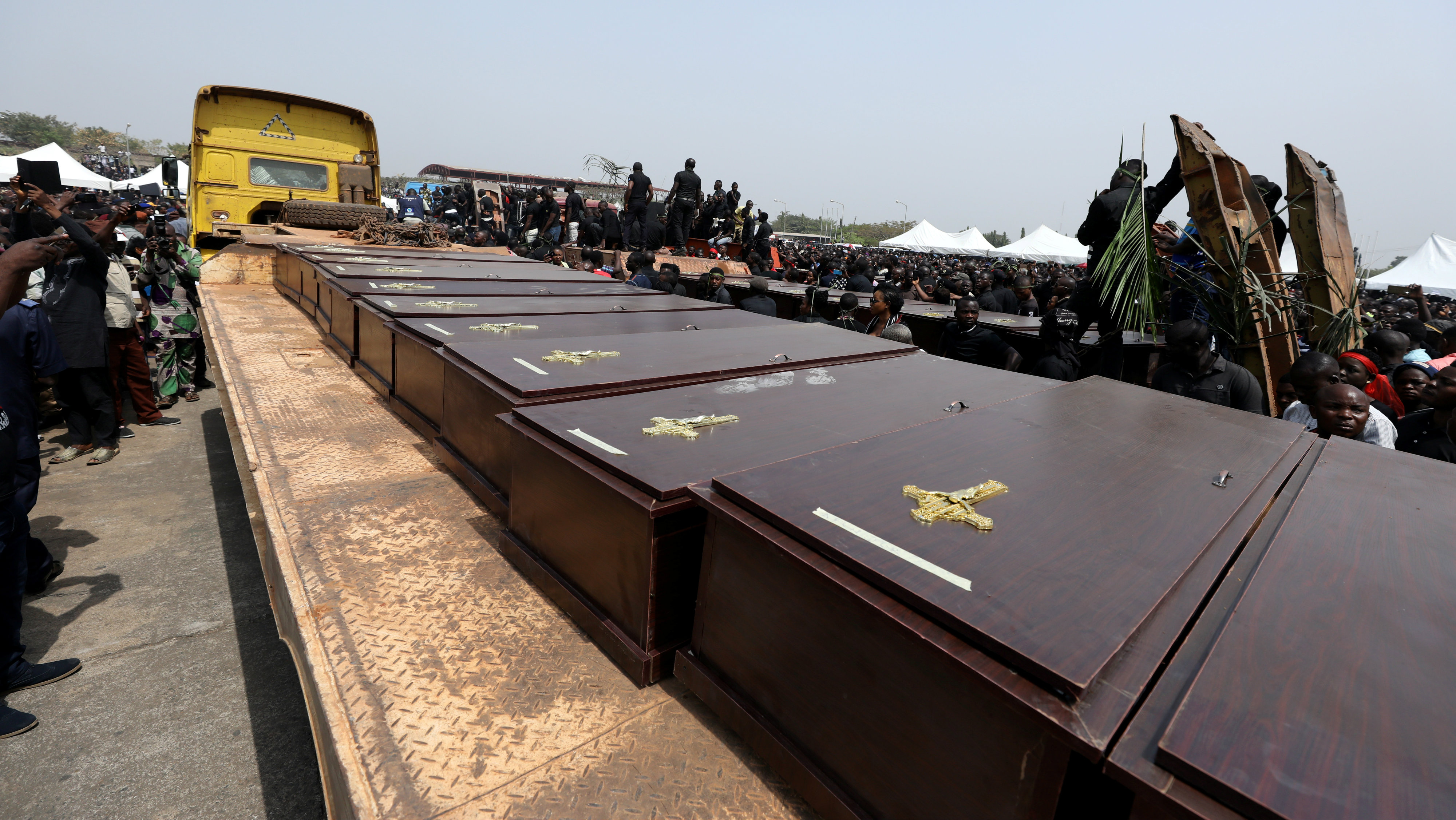 A truck carries the coffins of people killed by the Fulani herdsmen at the IBB square in Makurdi, Nigeria January 11, 2018.