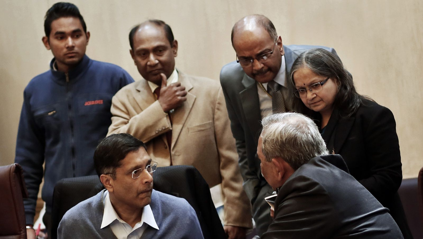 Chief economic adviser at India's Finance Ministry Arvind Subramanian (bottom L) listens to finance officials during their meeting in New Delhi January 8, 2015. A weak recovery from India's longest growth slowdown in decades is pushing Prime Minister Narendra Modi's advisers to consider loosening fiscal deficit targets
