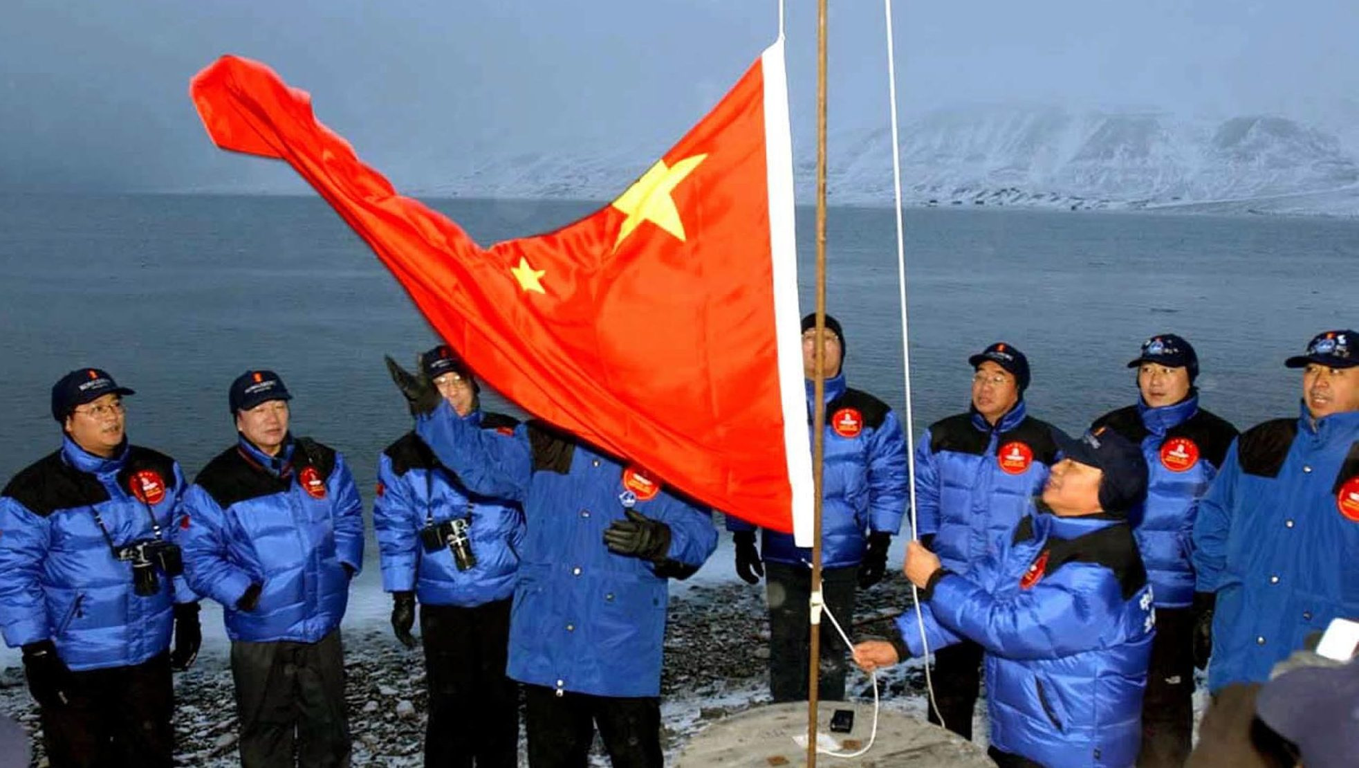 Members of the Chinese Yilite-Mulin Arctic Pole Expedition raise the Chinese national flag in Longyearbyen on Svalbard, Norway, to set the site of a Chinese research station on Wednesday, Oct. 31, 2001.  (AP Photo/Xinhua/Yuan Man)