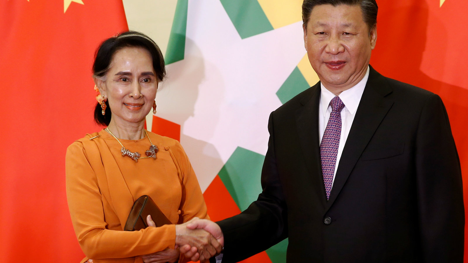 Myanmar State Counsellor Aung San Suu Kyi shakes hands with Chinese President Xi Jinping as they meet at the Great Hall of the People in Beijing, China, May 16, 2017.