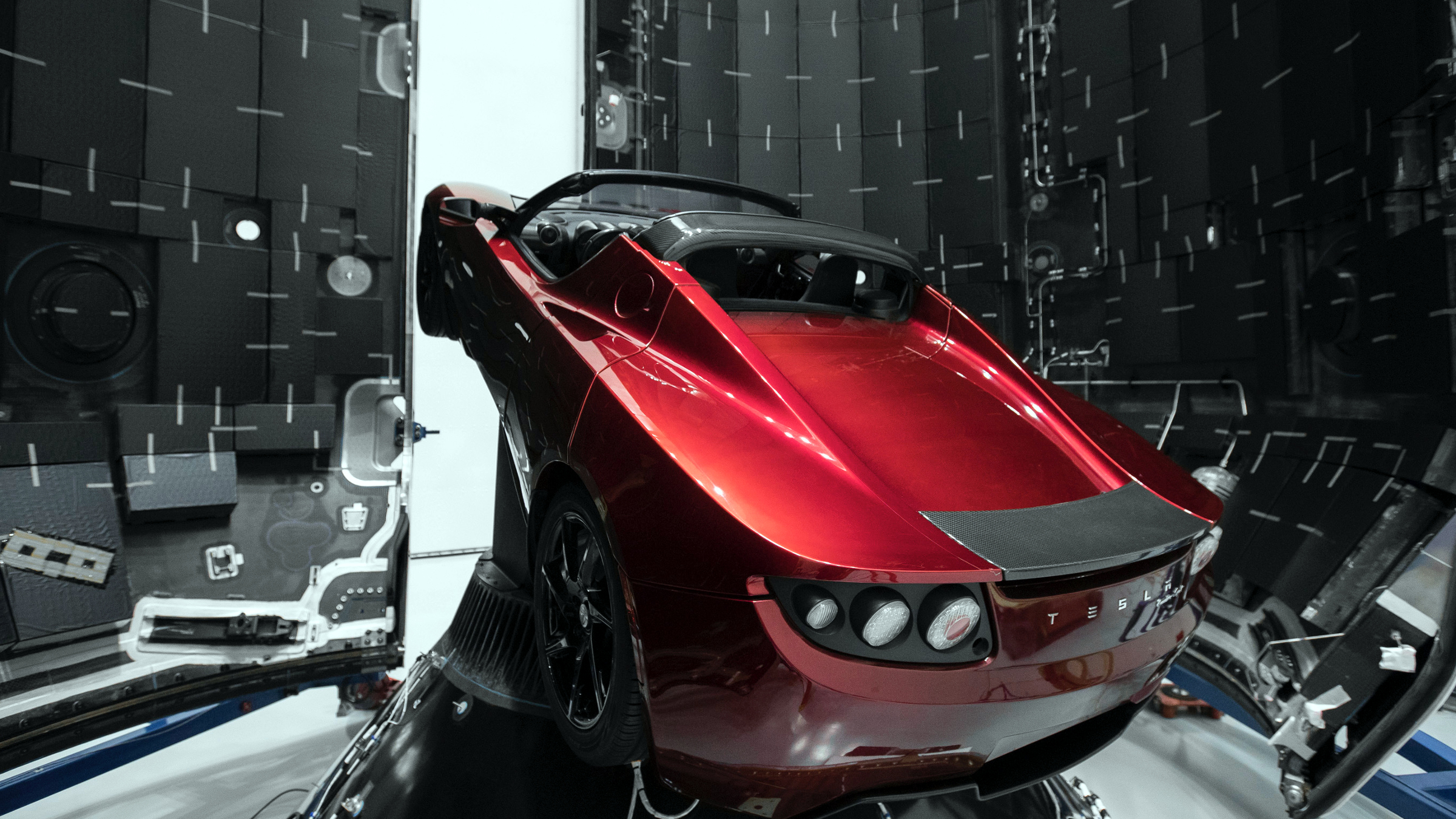 A Tesla roadster is tucked inside the carbon fiber fairing, or nose cone, on the Falcon Heavy rocket.