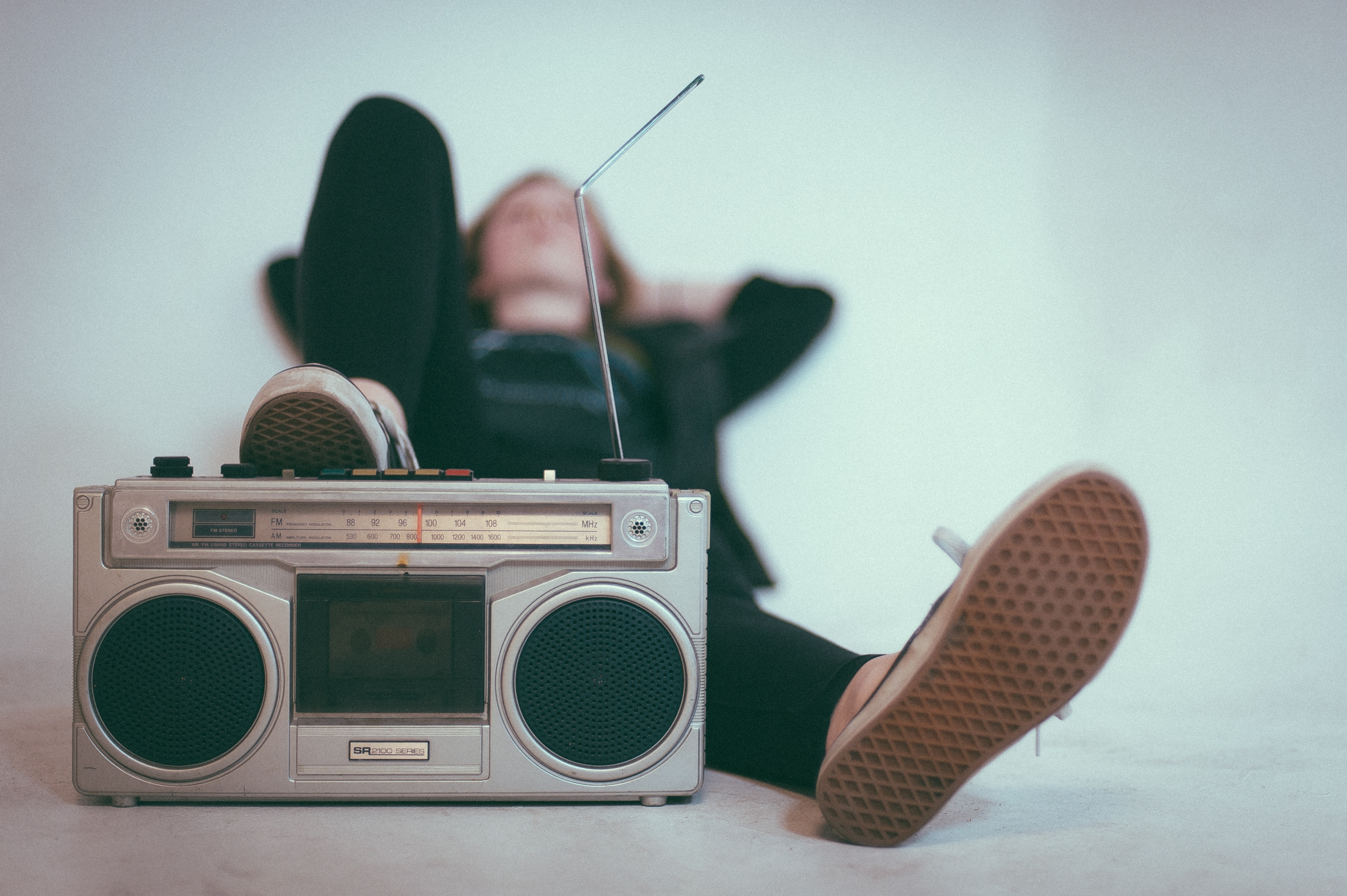 A woman listens to a radio