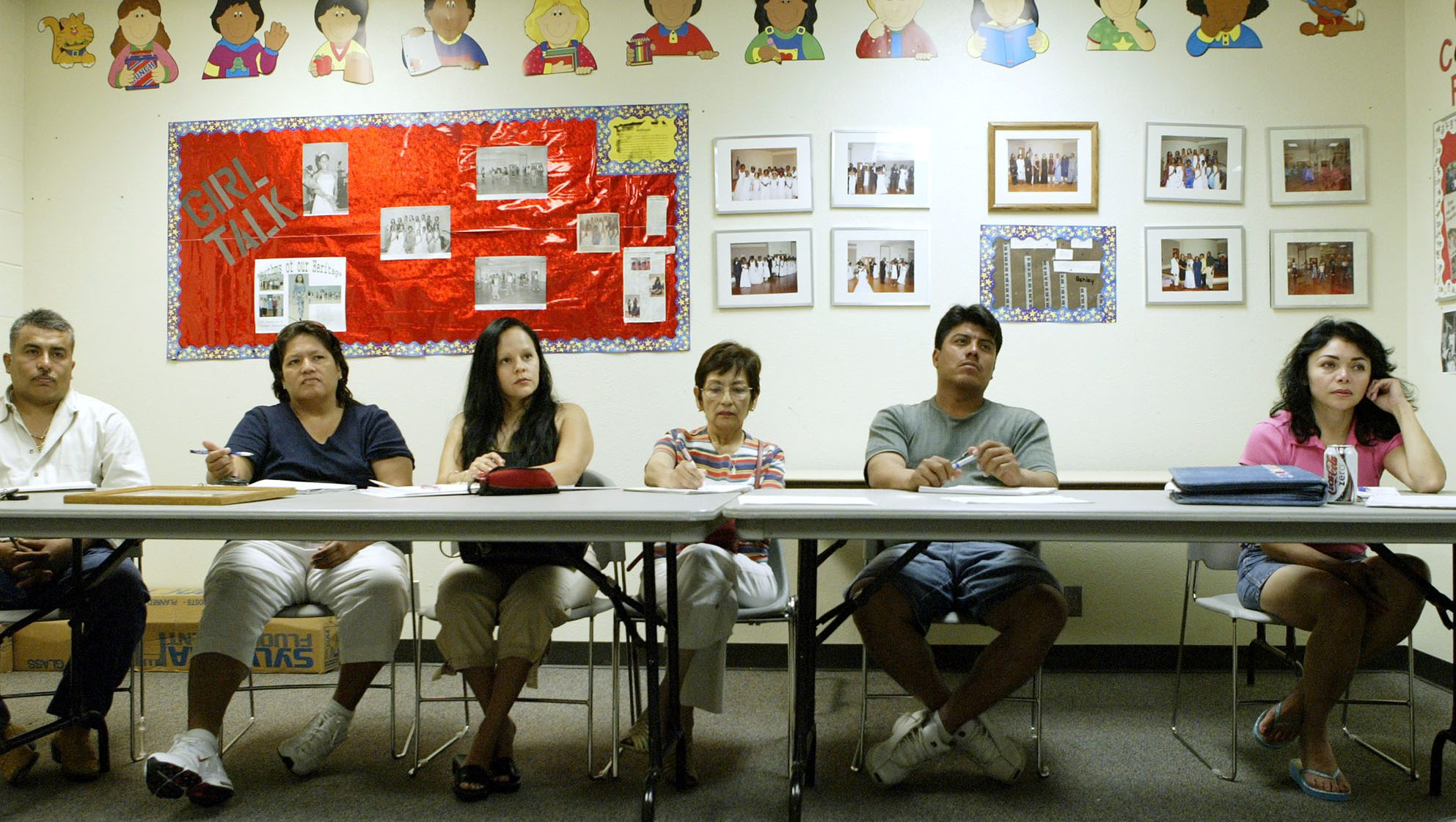 Students attend an English as a Second Language or ESL class at the Douglas Community Center June 8, 2006, in Plano, Texas. The Dallas suburbs of Plano, Irving, Carrollton and Farmers Branch along with other Texas cities have reported putting people on wait lists for ESL classes. Programs all over the country face the same.