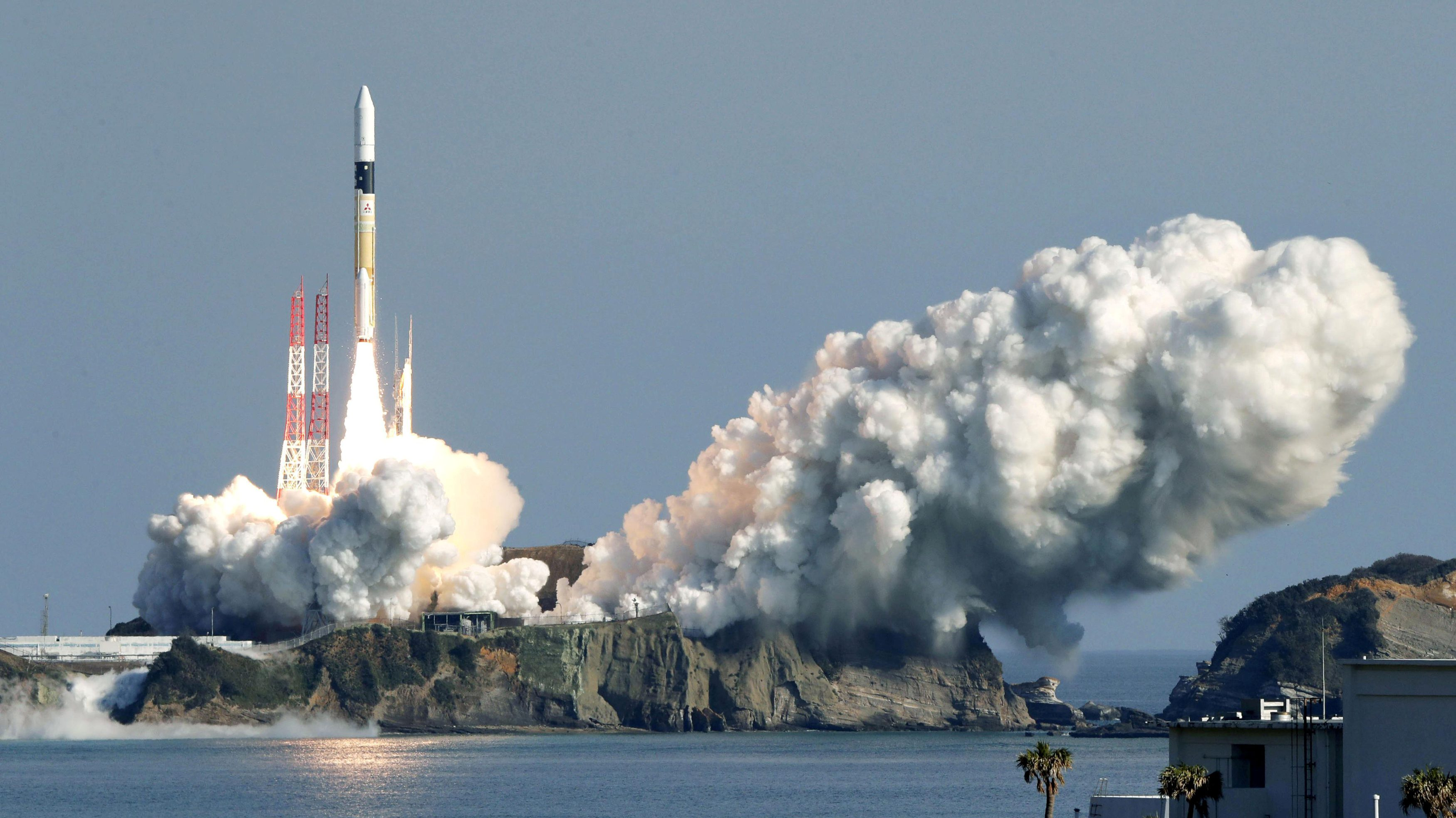 A H-IIA rocket carrying the satellites lifts off from the launching pad at Tanegashima Space Center in Tanegashima
