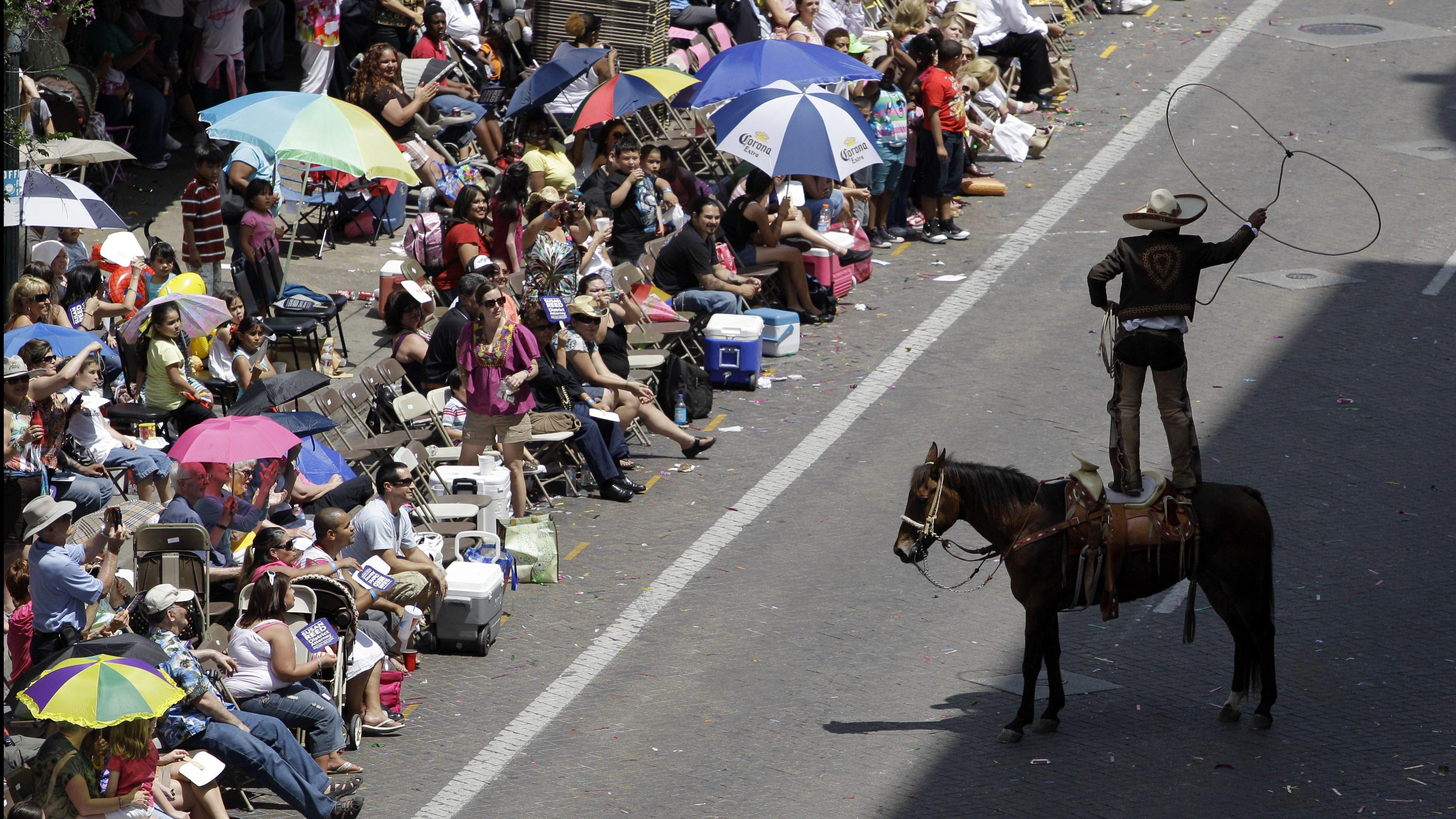 A charro performs rope tricks for parade goersin San Antonio, Texas.