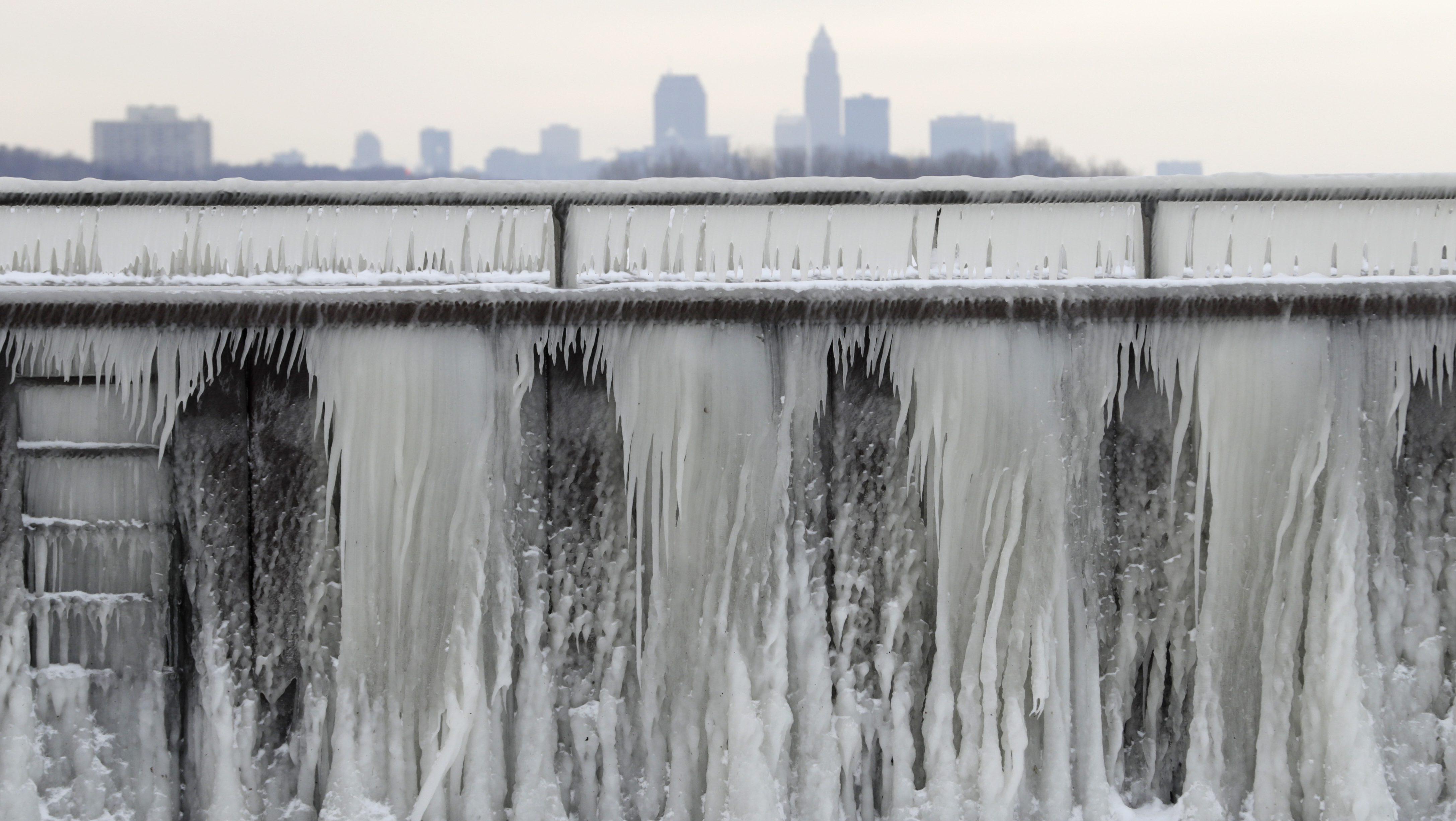 ce forms on a breakwall along Lake Erie with the city of Cleveland in the background, Wednesday, Jan. 3, 2018, in Cleveland. Dangerously cold temperatures have gripped wide swaths of the U.S. from Texas to New England.