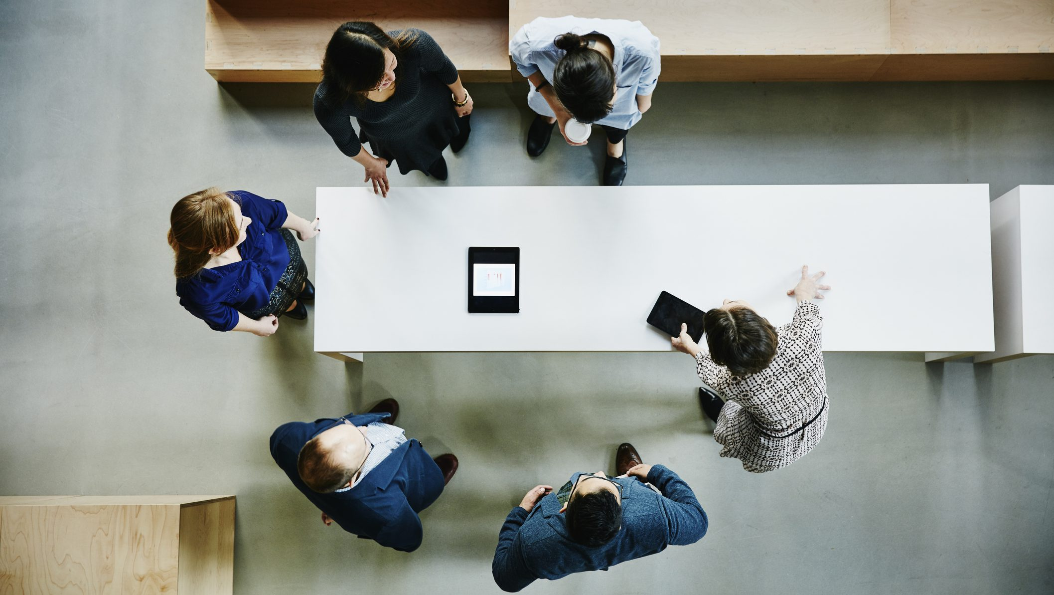 Overhead view of businesswoman leading meeting