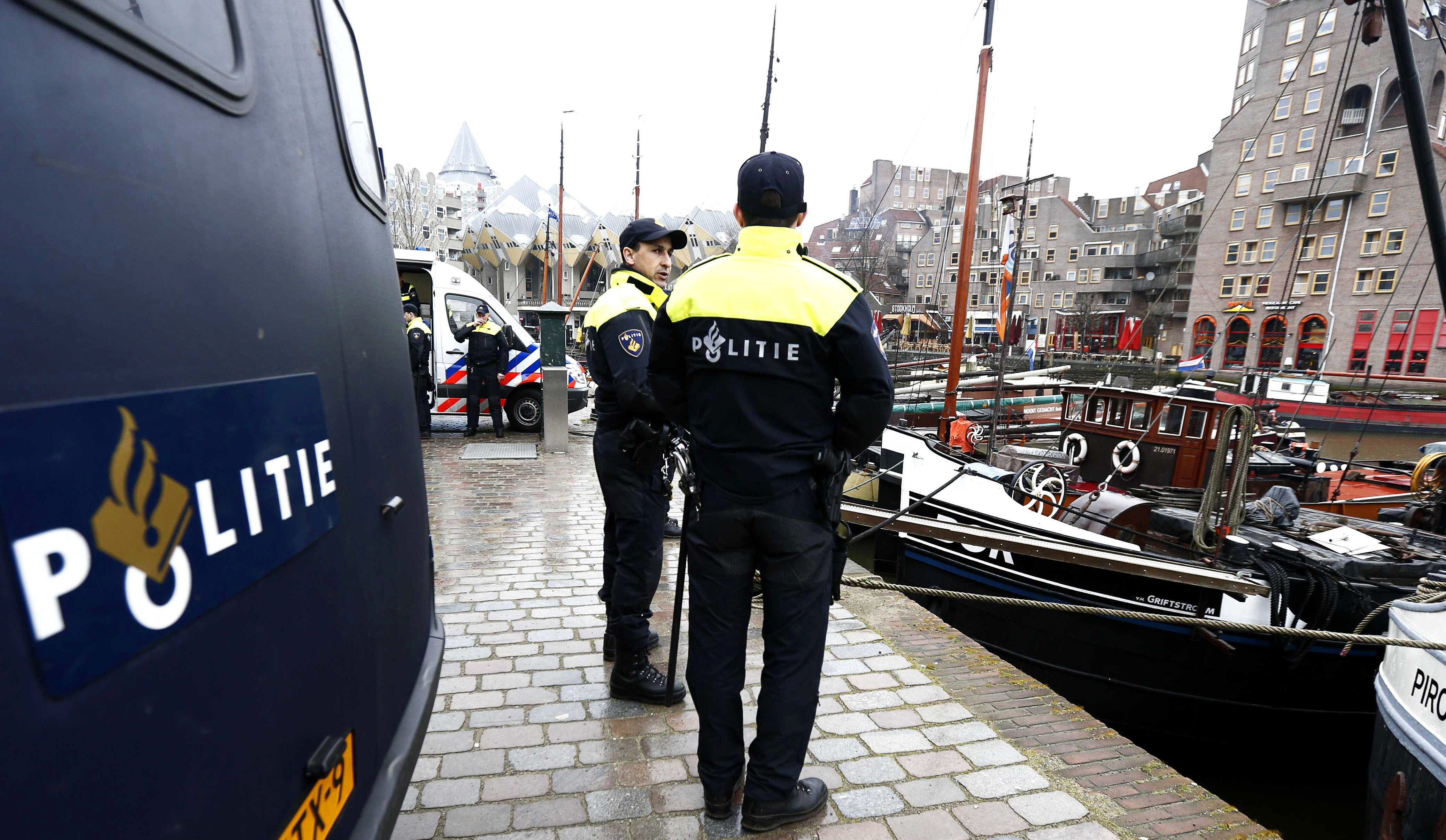 epa04638226 Dutch members of the police force safeguard the historic old port in Rotterdam, Netherlands, 26 February 2015, ahead of the UEFA Europa League round of 32 second leg soccer match between Feyenoord Rotterdam and AS Roma. Fans of AS Roma will be gathered around the port ahead of the match.  EPA/JERRY LAMPEN