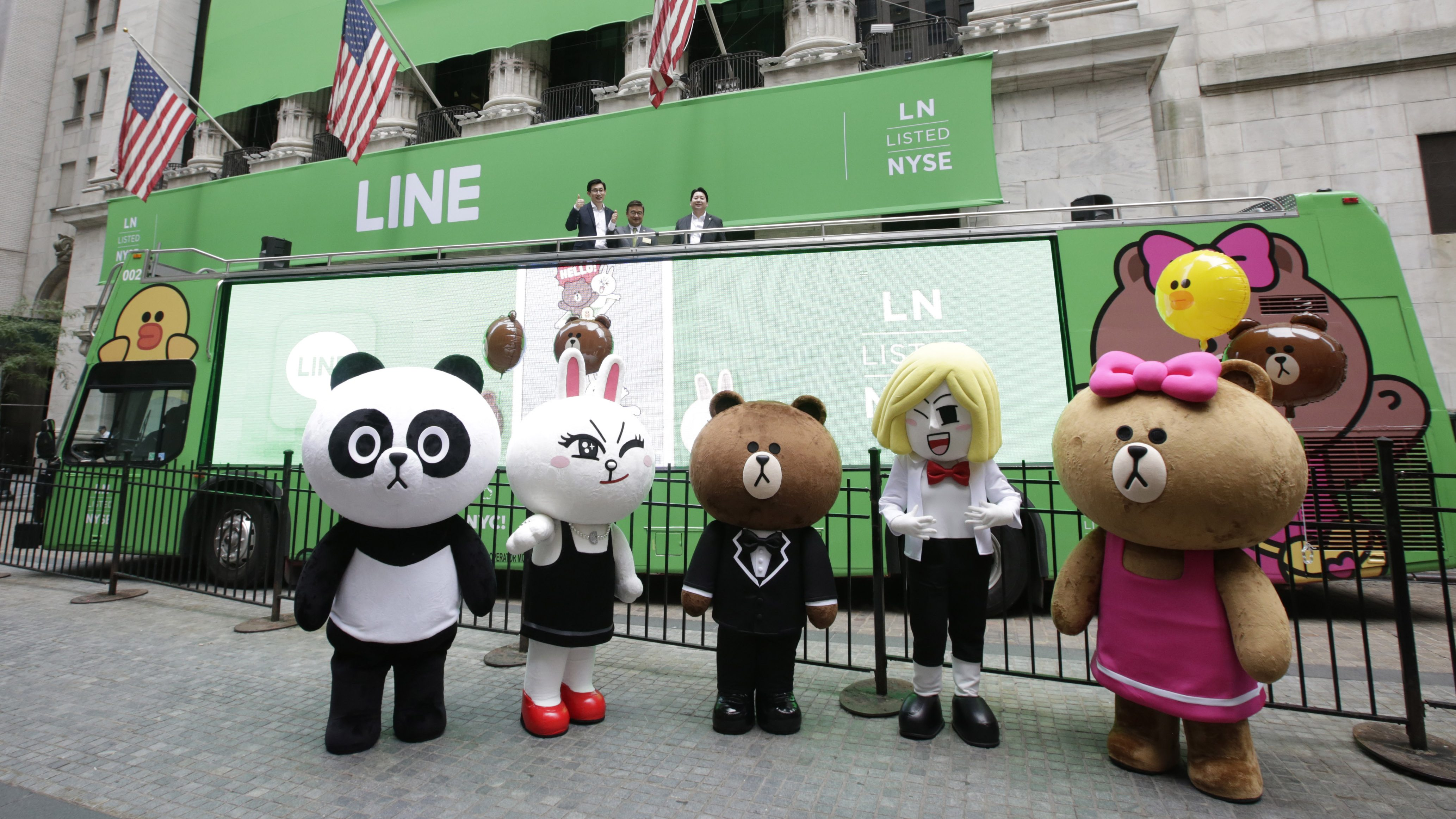 Line characters pose for photos before the company's IPO at the New York Stock Exchange (NYSE) during the first trading of shares in the Japanese messaging-app operator Line Corp offering in New York, New York, USA, 14 July 2016.