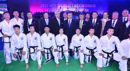 South Korean President Moon Jae-in (C) poses with a North Korean taekwondo team while attending the opening ceremony of the World Taekwondo Federation's World Taekwondo Championships in Muju, some 240km south of Seoul, South Korea, 24 June 2017. The North Korean squad participated in the seven-day event to demonstrate during its opening and closing ceremonies.