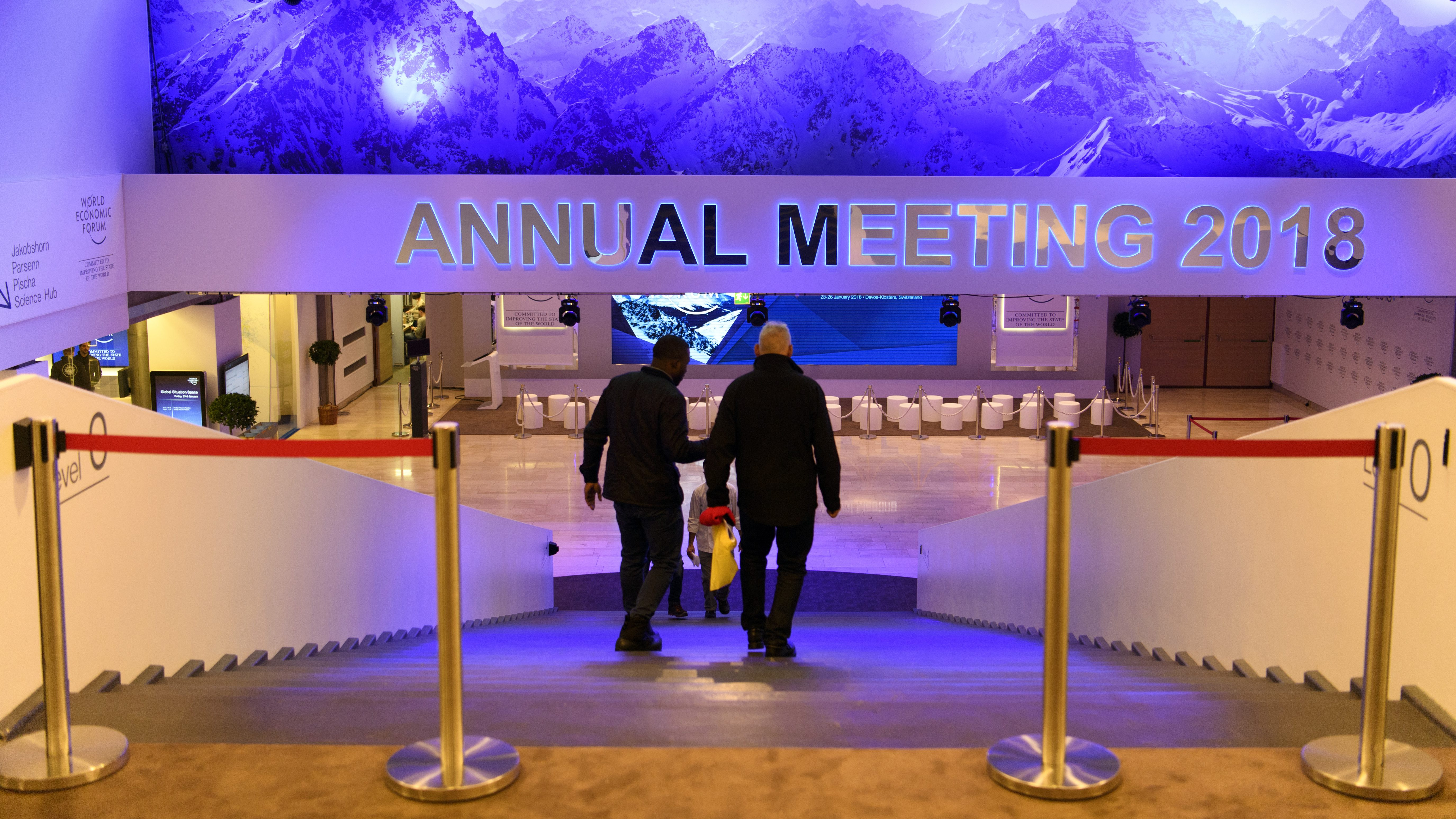 Workers walk inside the Congress Centre two days prior to the 48th Annual Meeting of the World Economic Forum (WEF), in Davos, Switzerland, 21 January 2018. The meeting brings together enterpreneurs, scientists, chief executive and political leaders in Davos from 23 to 26 January.