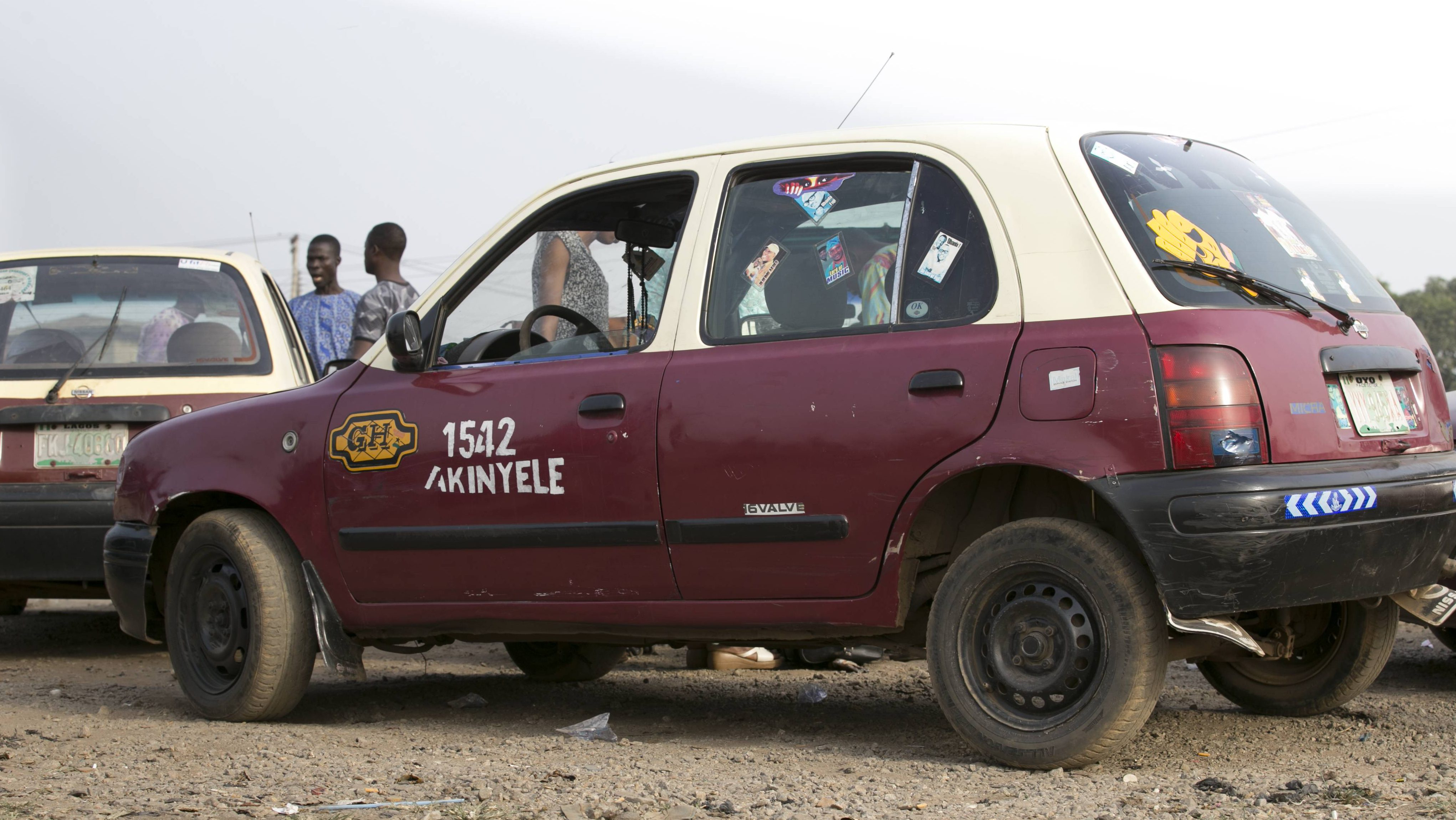 The Nissan Micra in local taxi colors in Ibadan