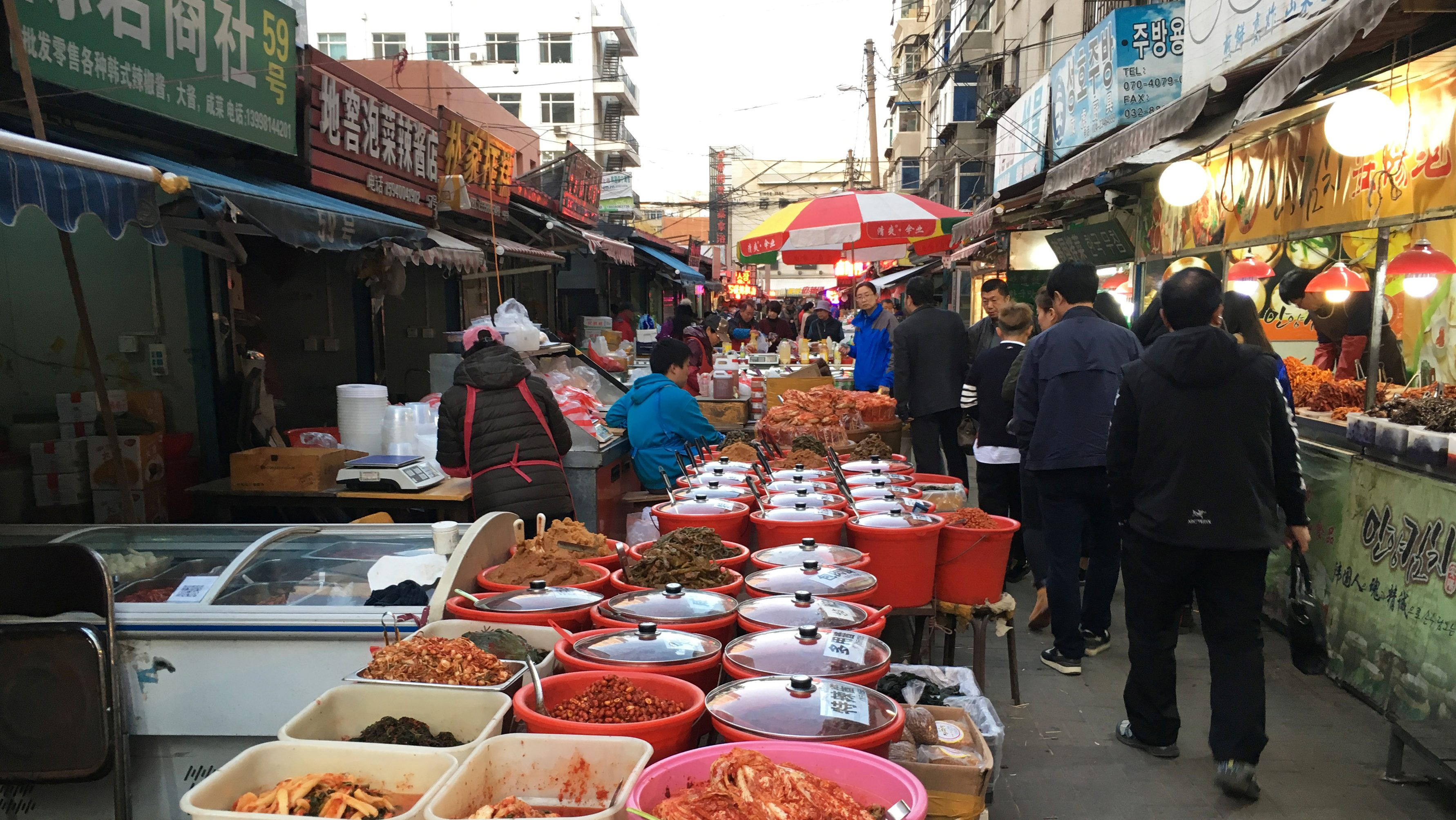 Kimchi and other food are sold at a market in Shenyang's Xita District, Liaoning province, China November 1, 2017. Picture taken November 1, 2017. REUTERS/ Sue-Lin Wong - RC179AF5E8F0