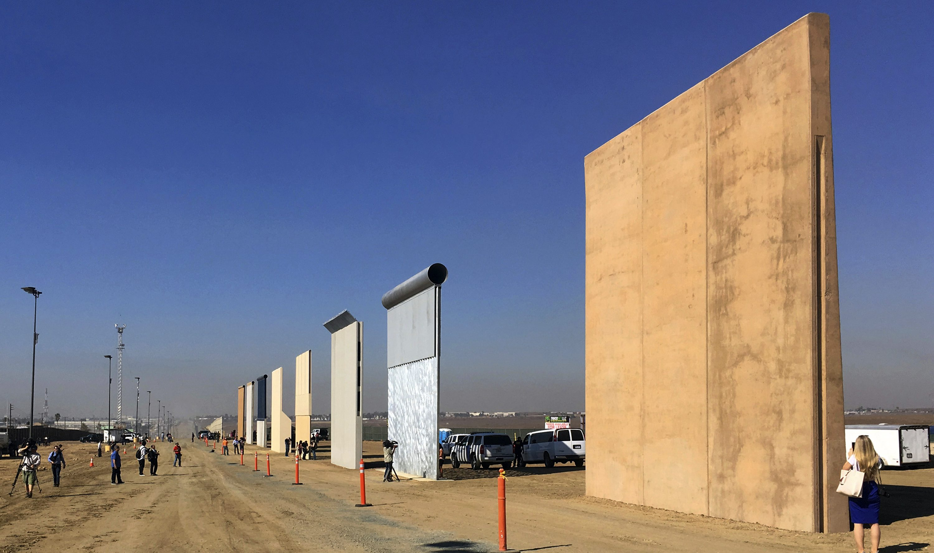 This Oct. 26, 2017 file photo shows prototypes of border walls in San Diego. The Trump administration has proposed spending $18 billion over 10 years to significantly extend the border wall with Mexico. The plan provides one of the most detailed blueprints of how the president hopes to carry out a signature campaign pledge.