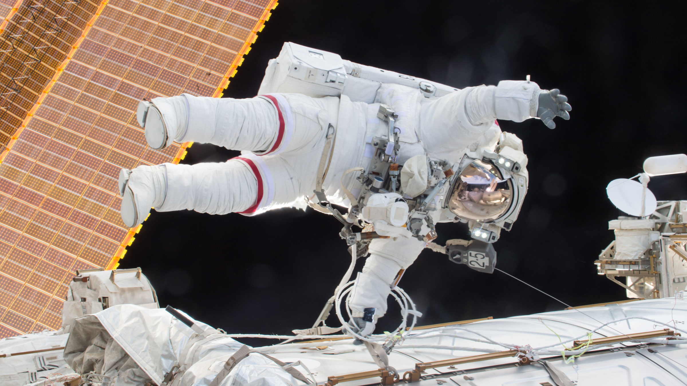 International Space Station Expedition 46 Commander Scott Kelly during a spacewalk, in which Kelly and Flight Engineer Tim Kopra successfully moved the International Space Station's mobile transporter rail car ahead of a docking of a Russian cargo supply spacecraft, December 21, 2015. After quickly completing their primary objective for the spacewalk, Kelly and Kopra tackled several additional tasks. Kelly routed a second pair of cables in preparation for International Docking Adapter installment work to support U.S. commercial crew vehicles. Kopra routed an Ethernet cable that ultimately will connect to a Russian laboratory module. They also retrieved tools that had been in a toolbox on the outside of the station, so they can be used for future work.