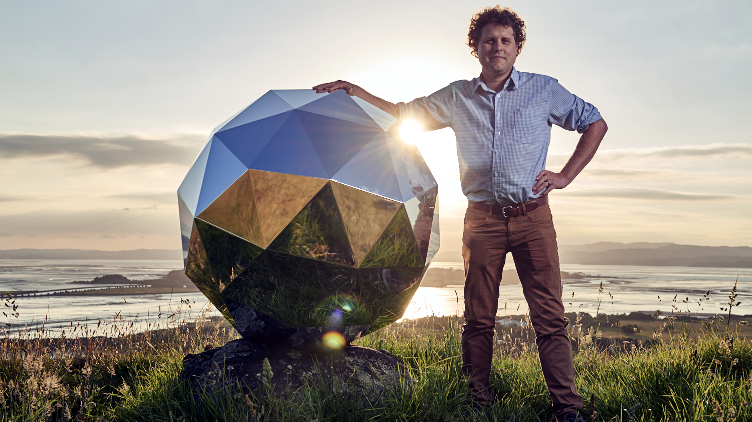 Rocket Lab CEO Peter Beck with the Humanity Star, a satellite designed to be visible from orbit.