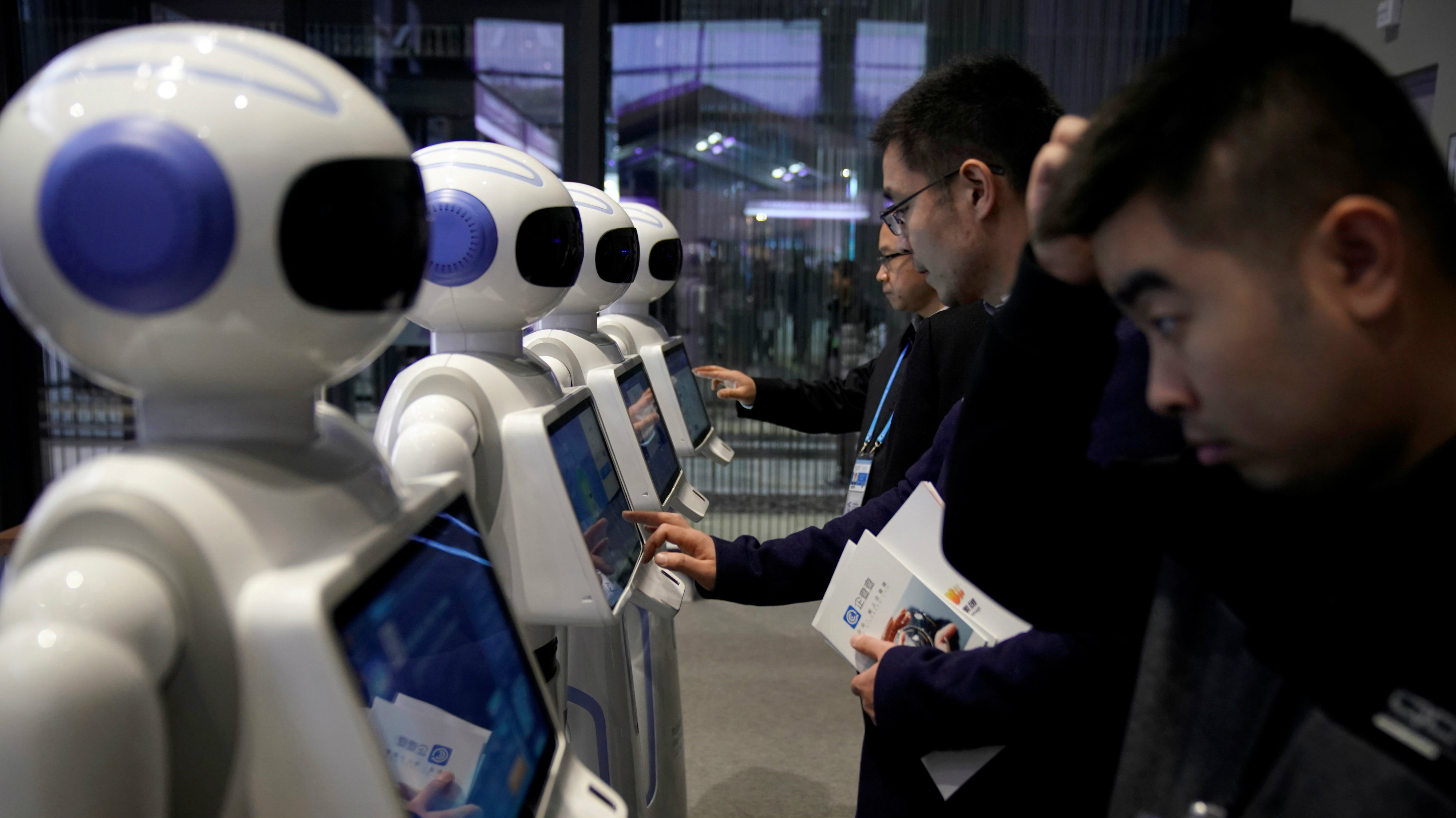 People look at Xiao Qiao robots during the fourth World Internet Conference in Wuzhen, Zhejiang province, China, December 3, 2017.
