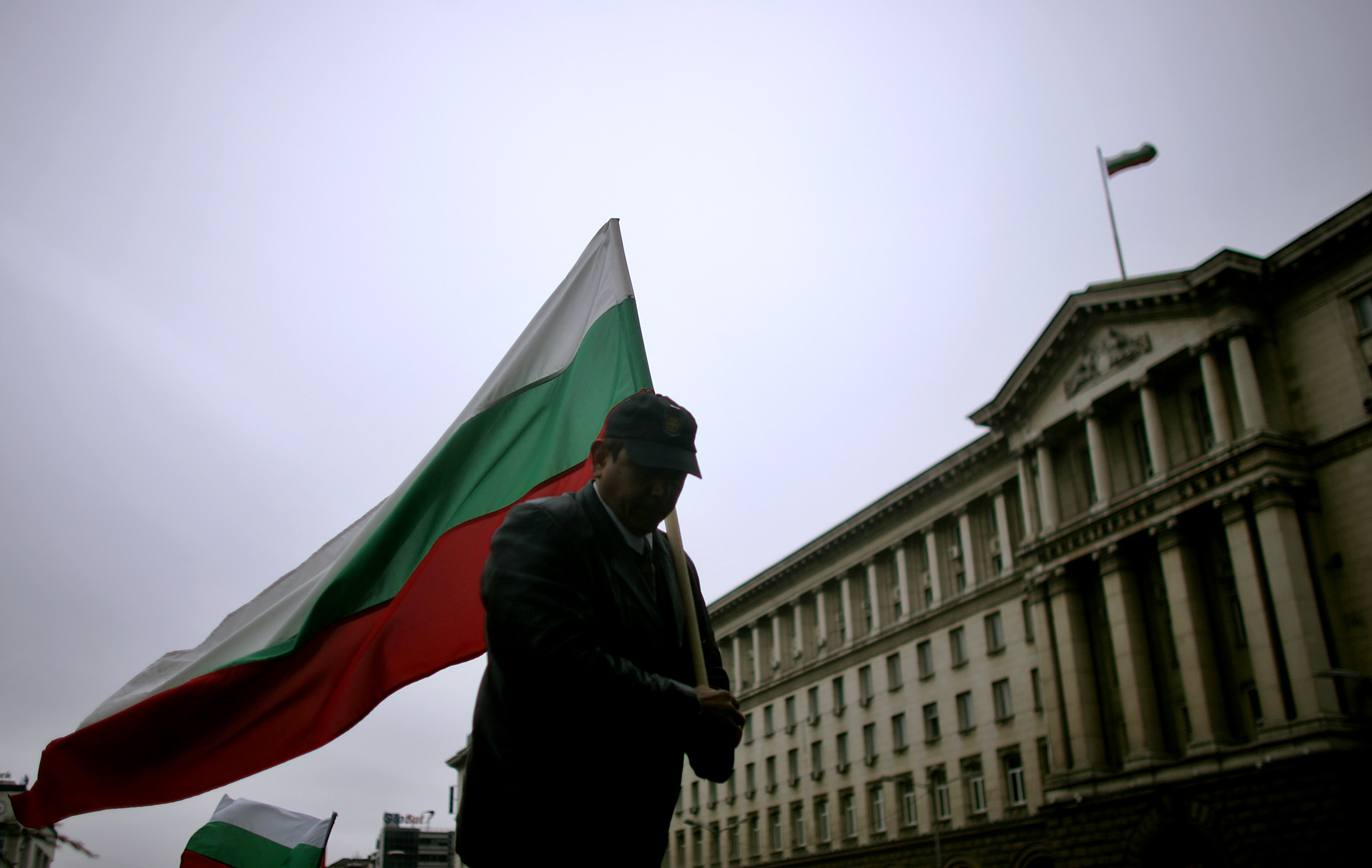 A man holds the Bulgarian flag during a protest in central Sofia
