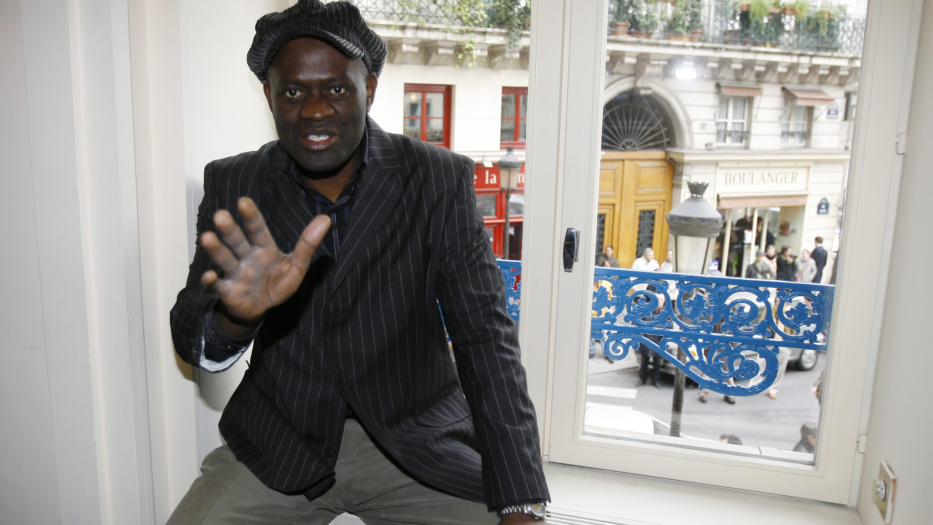 French Congolese born author Alain Mabanckou poses for photographers at the Drouant restaurant in Paris