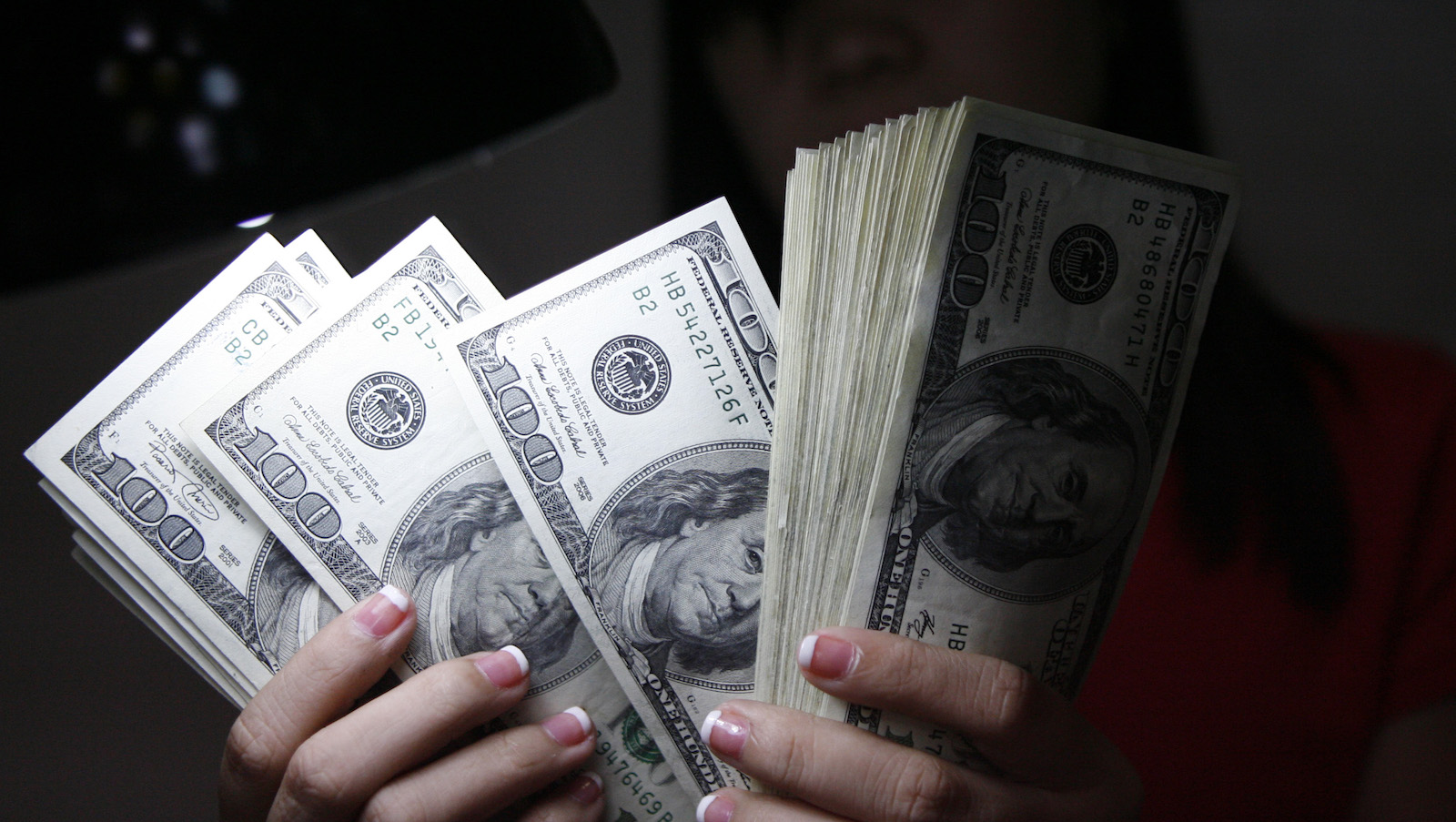 a woman holds money