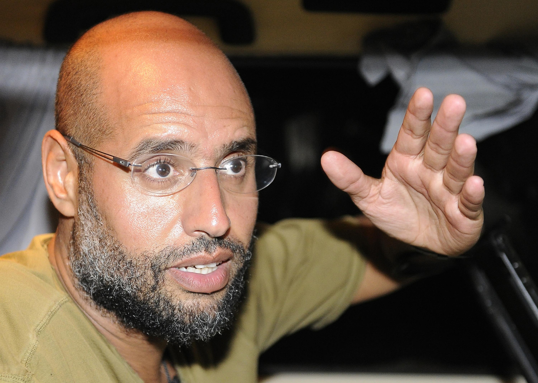 Saif Al-Islam, son of Libyan leader Muammar Gaddafi, gestures as he talks to reporters in Tripoli August 23, 2011.