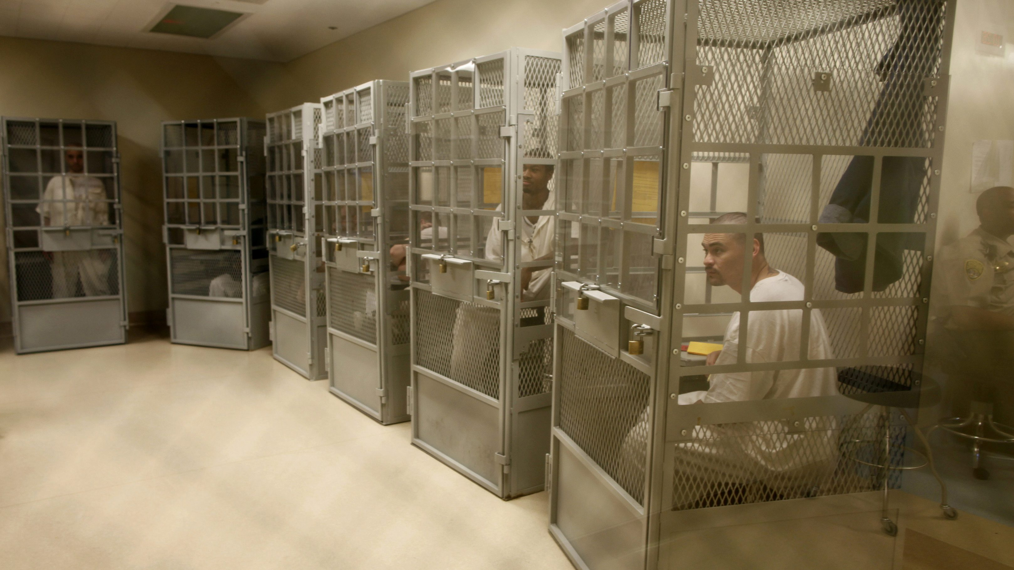 Administrative segregation prisoners take part in a group therapy session at San Quentin state prison