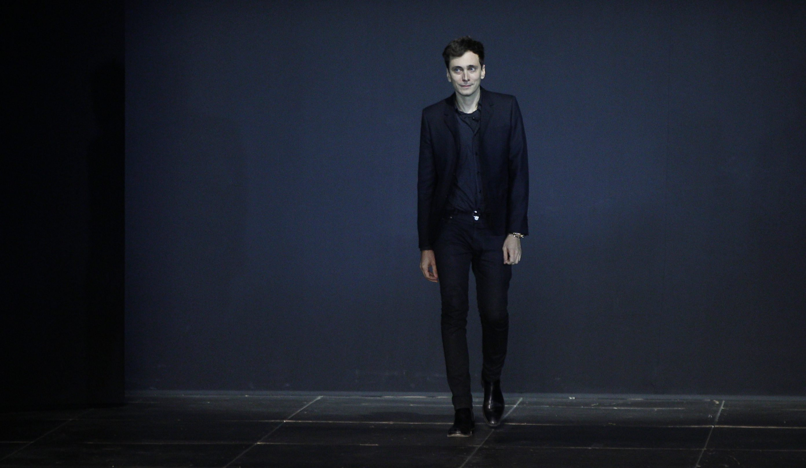 French designer Hedi Slimane appears at the end of his Spring/Summer 2013 women's ready-to-wear fashion show for French fashion house Saint Laurent Paris during Paris fashion week October 1, 2012. REUTERS/Gonzalo Fuentes (FRANCE - Tags: FASHION) - LR1E8A11M75HB