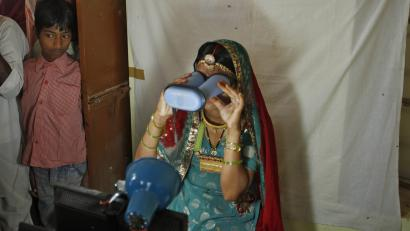 A villager goes through the process of eye scanning for UID database system at an enrolment centre at Merta district in Rajasthan