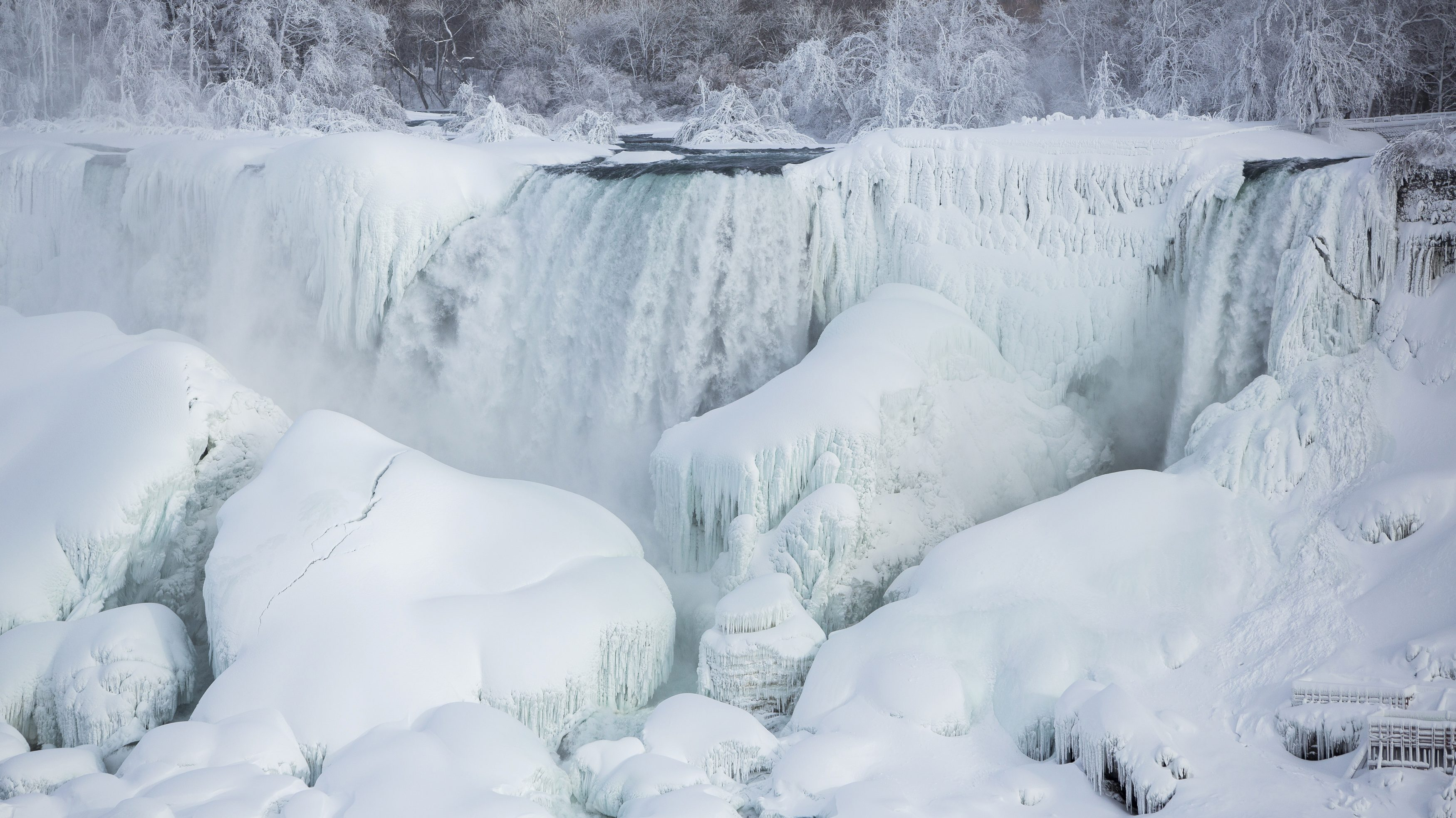 A partially frozen American Falls in sub freezing temperatures is seen in Niagara Falls, Ontario February 17, 2015. Temperature dropped to 6 degrees Fahrenheit (-14 Celsius) on Tuesday. The National Weather Service has issued Wind Chill Warning in Western New York from midnight Wednesday to Friday.