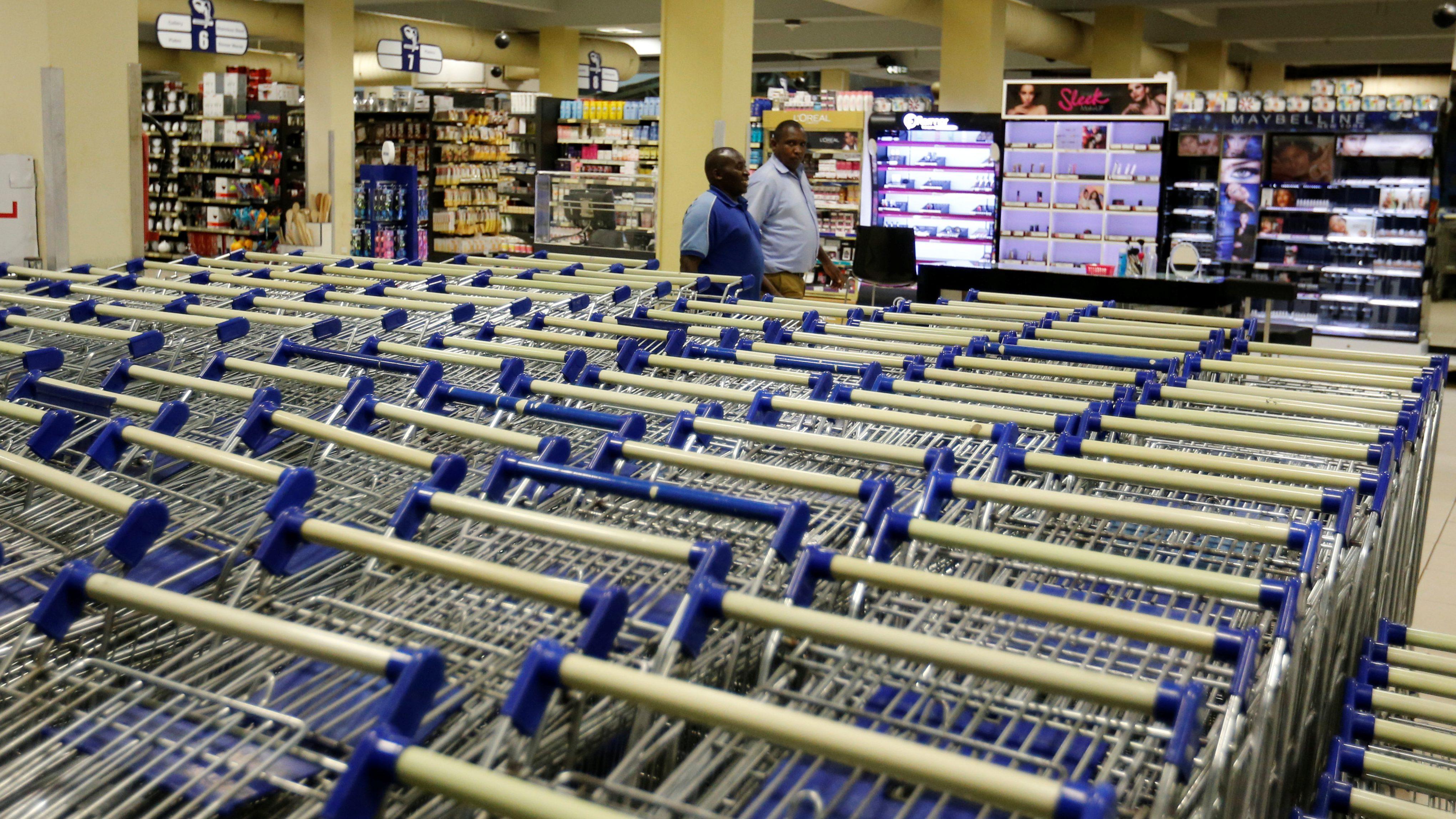 Shopping trolleys are seen arranged inside the Nakumatt supermarket within the Village market complex mall, in Nairobi, Kenya.