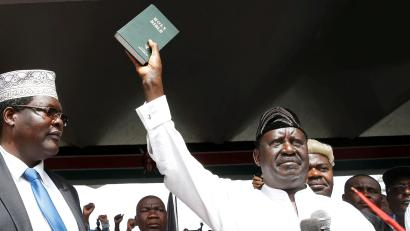 Kenyan opposition leader Raila Odinga of the National Super Alliance (NASA) holds a bible as he takes a symbolic presidential oath of office in Nairobi, Kenya January 30, 2018.
