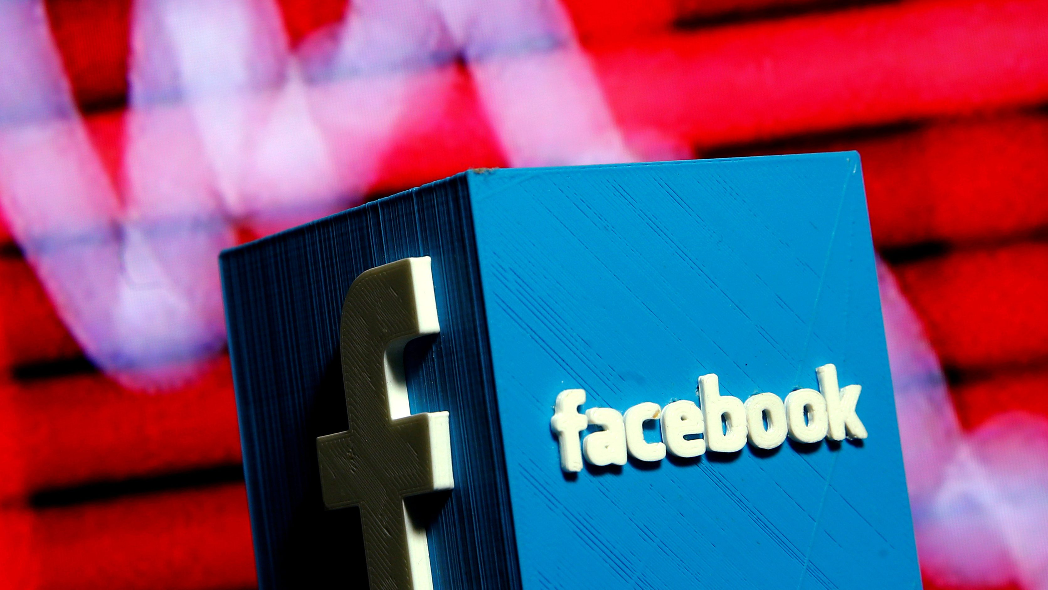 FILE PHOTO:    A 3D-printed Facebook logo is seen in front of a displayed stock graph in this illustration taken November 3, 2016.  REUTERS/Dado Ruvic/Illustration/File Photo - RC1942532850