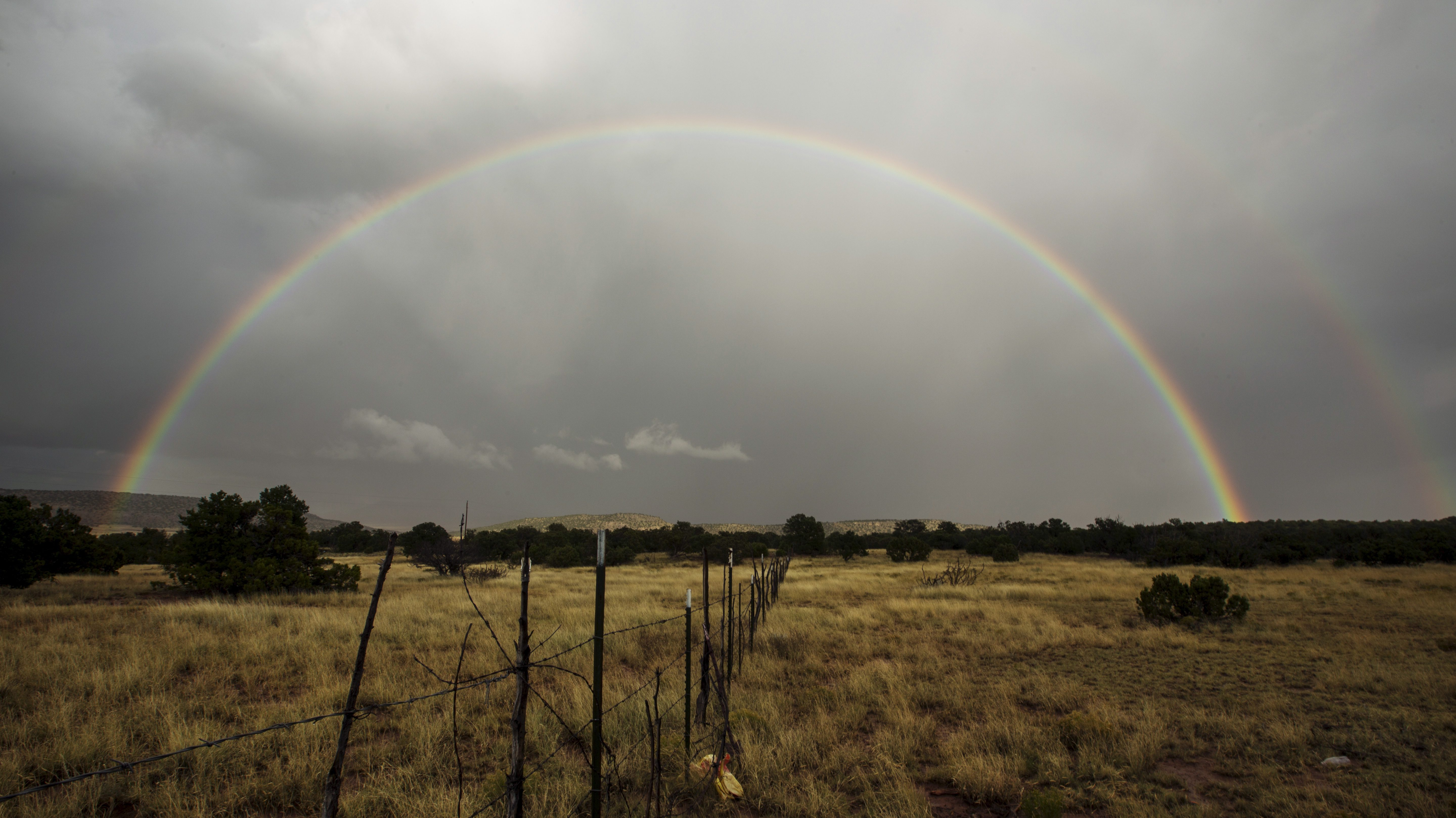 A rainbow forms after a passing rain shower near Grants, New Mexico, October 5, 2015.    - GF10000233617