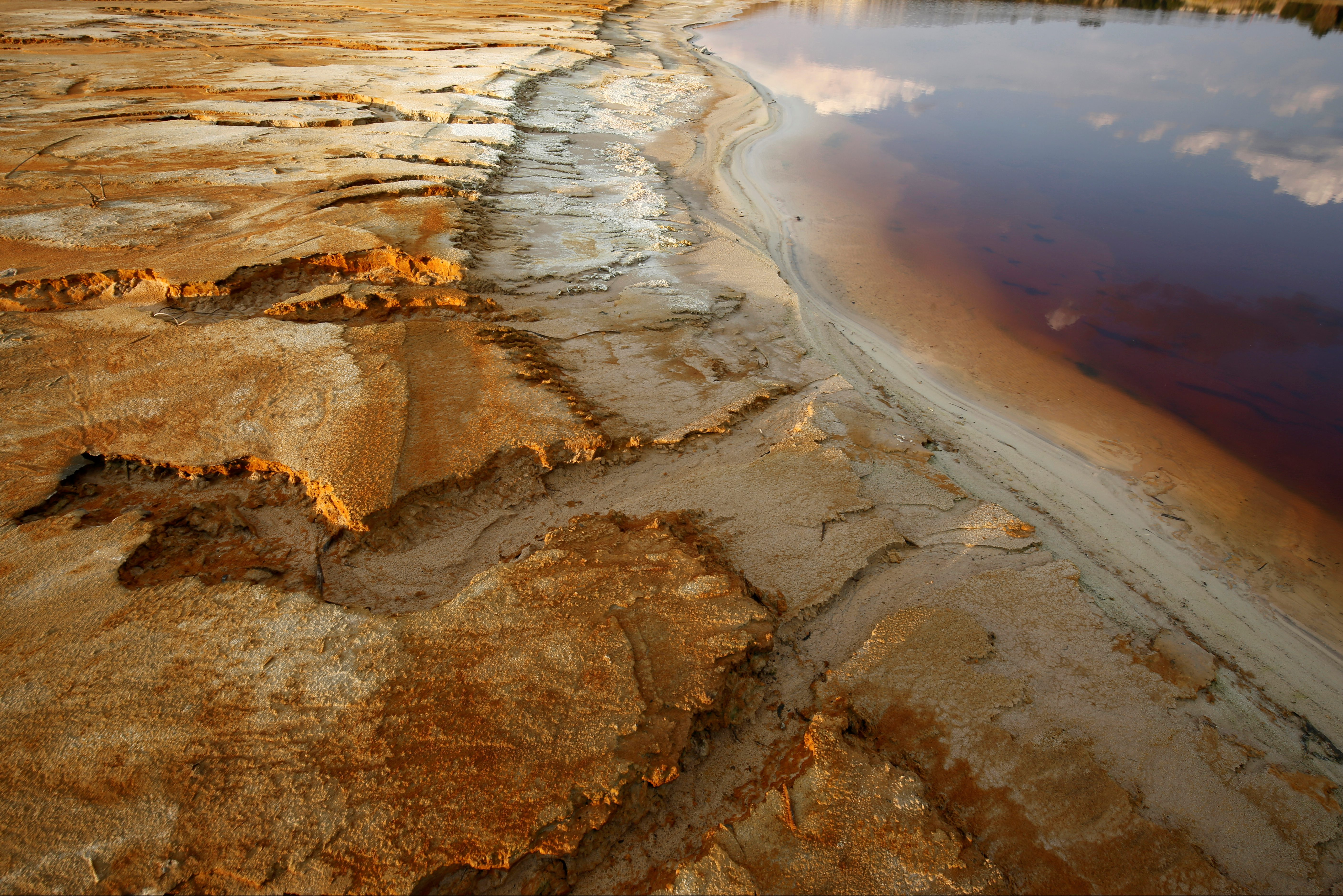 Polluted water emanating from mining operations fills a dam near Johannesburg