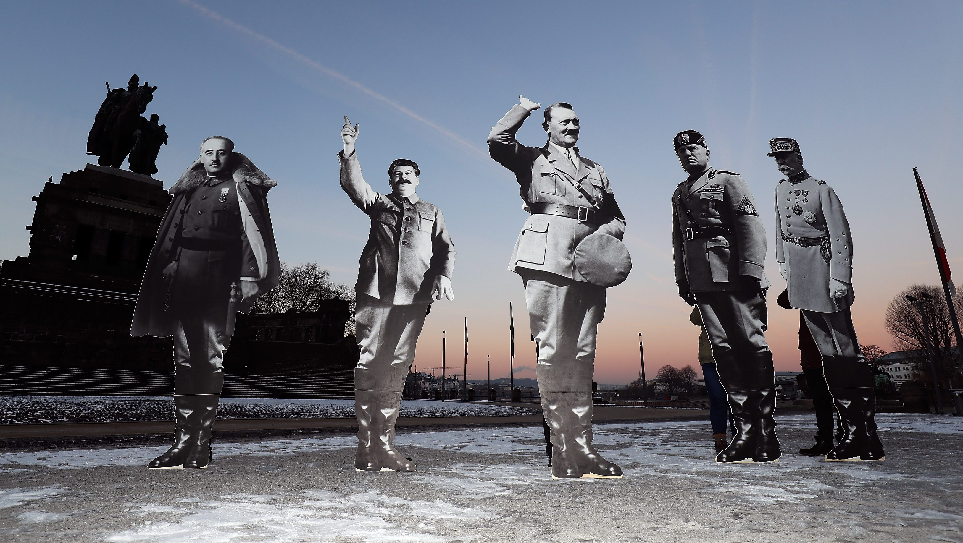"Members of the campaigning community Avaaz placed life-size cardboards, depicting Benito Mussolini, Adolf Hitler, Josef Stalin, Francisco Franko and Philippe Petain in front of the Kaiser Wilhelm monument at the Deutsches Eck (""German Corner"") to protest against a European far-right leaders meeting, in Koblenz, Germany, January 21, 2017."