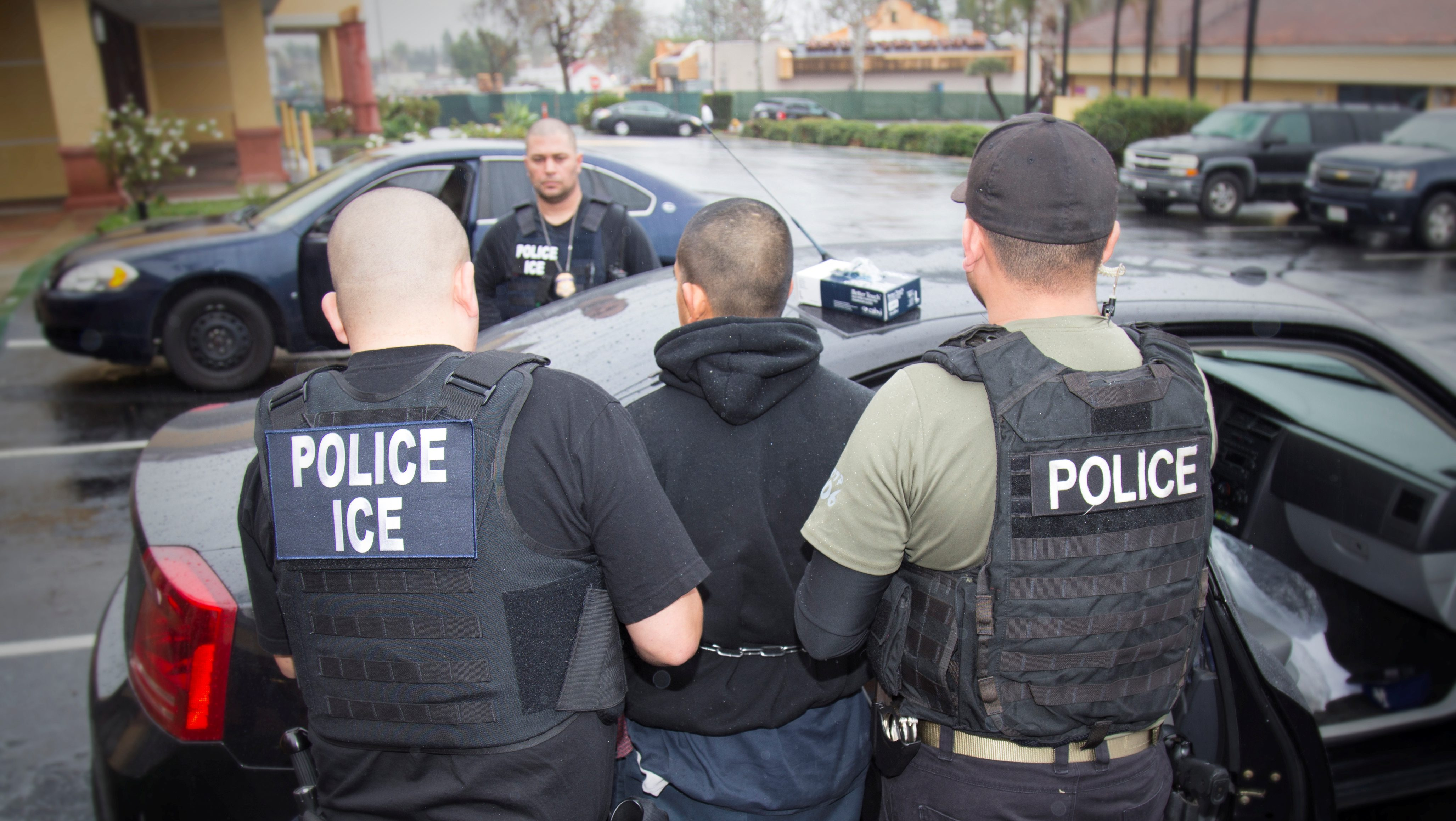 U.S. Immigration and Customs Enforcement (ICE) officers detain a suspect as they conduct a targeted enforcement operation in Los Angeles, California, U.S. on February 7, 2017. Picture taken on February 7, 2017.