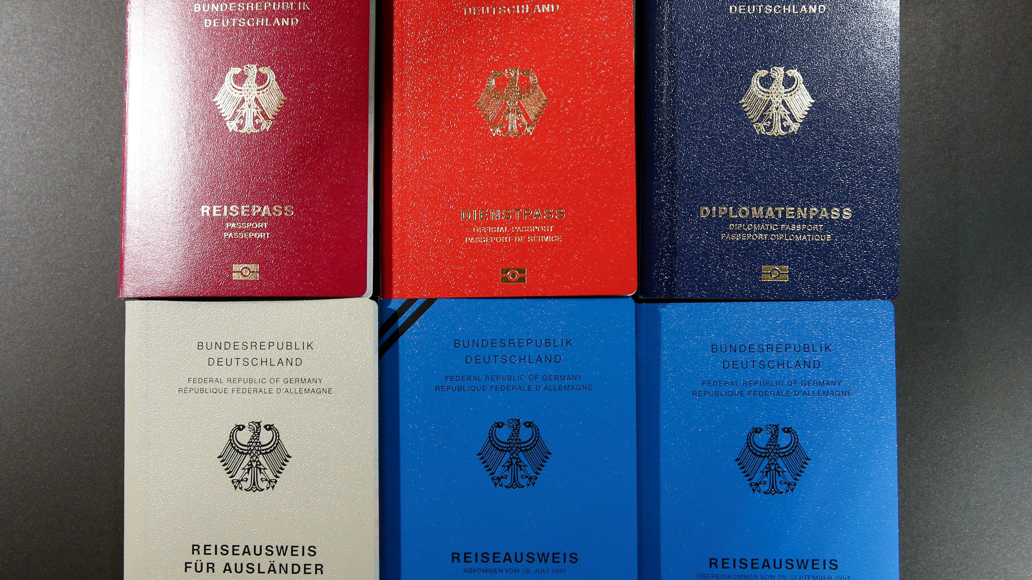 Specimens of German new electronic passports are pictured during a presentation to the media in Berlin, Germany, February 23, 2017.     REUTERS/Fabrizio Bensch - RC1448508130