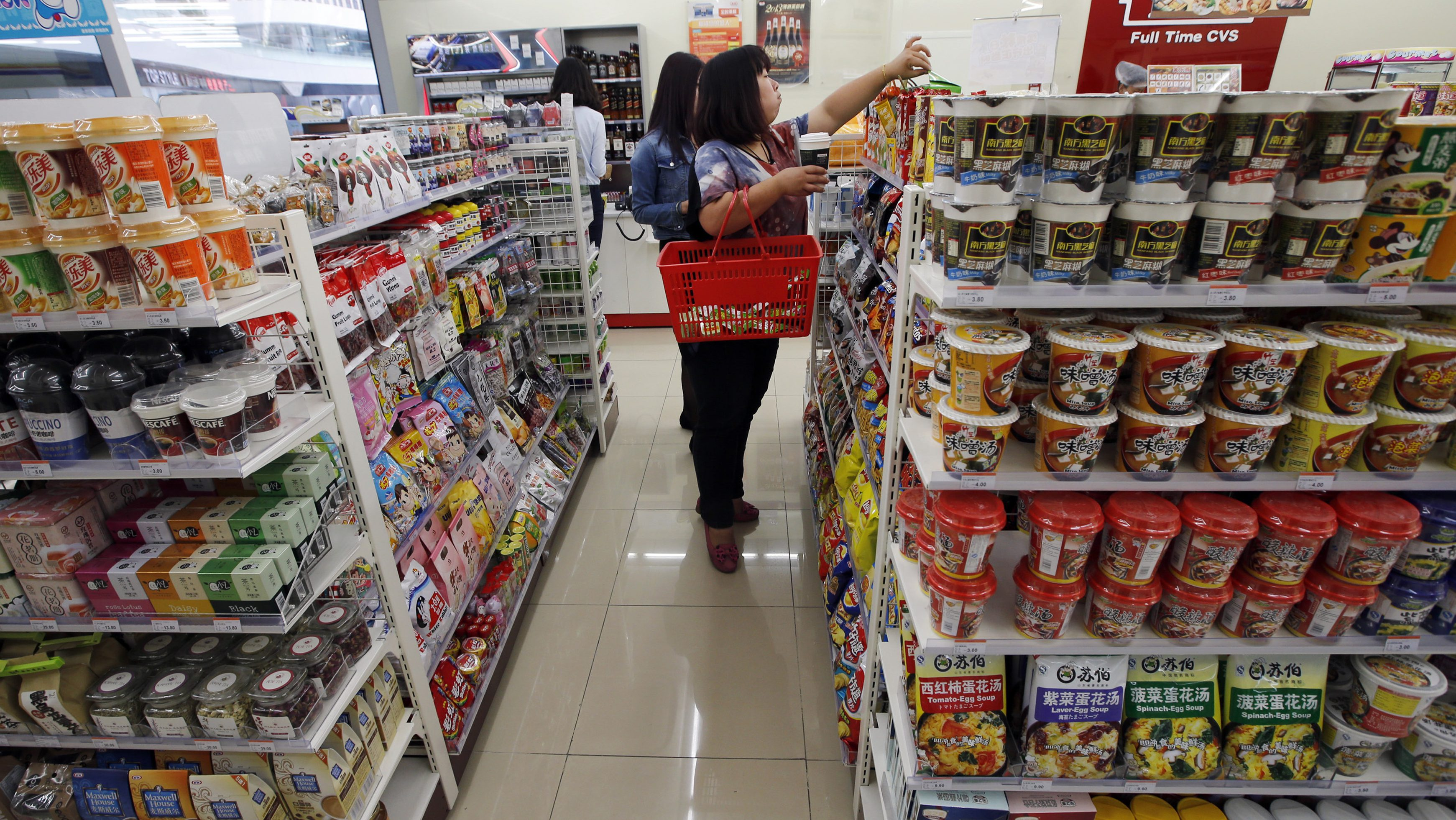 Customers choose goods at a shop in Beijing October 14, 2013.
