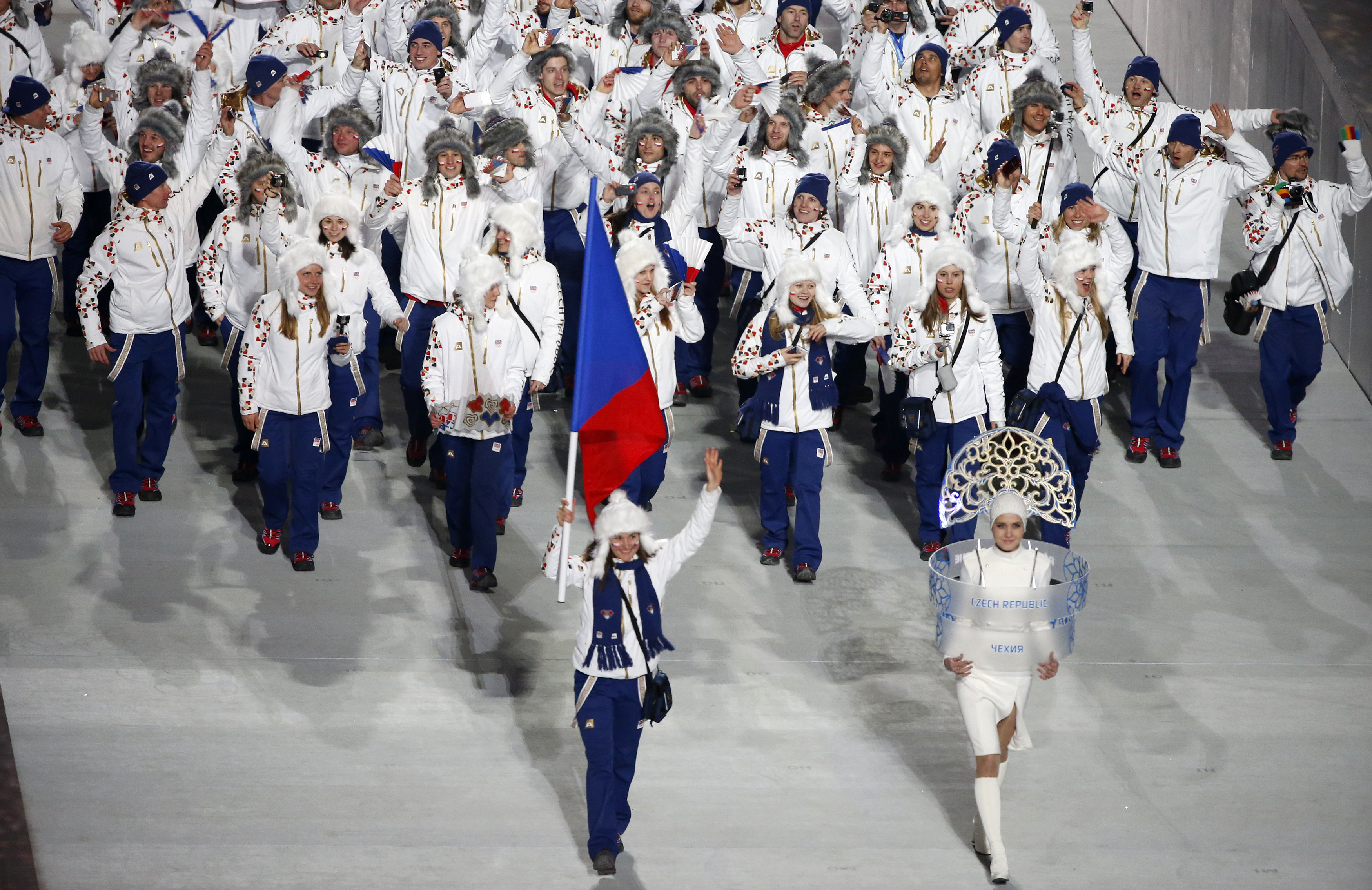 Flag-bearer Strachova of the Czech Republic leads her country's contingent during the athletes' parade at the opening ceremony of the 2014 Sochi Winter Olympics