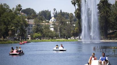 People ride paddle boats on a hot day at Echo Park Lake in Los Angeles, California